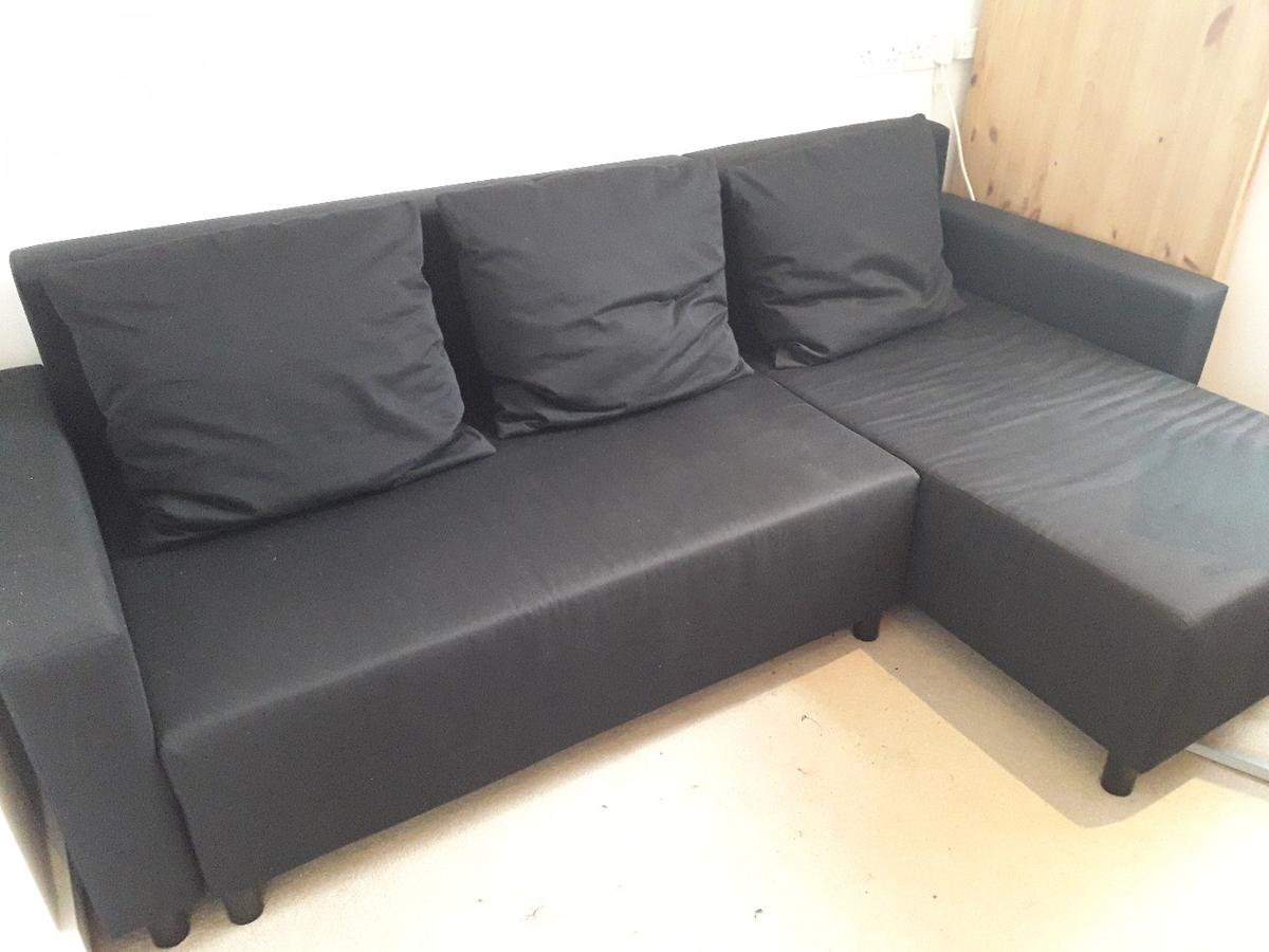Black corner sofa bed with storage - IKEA