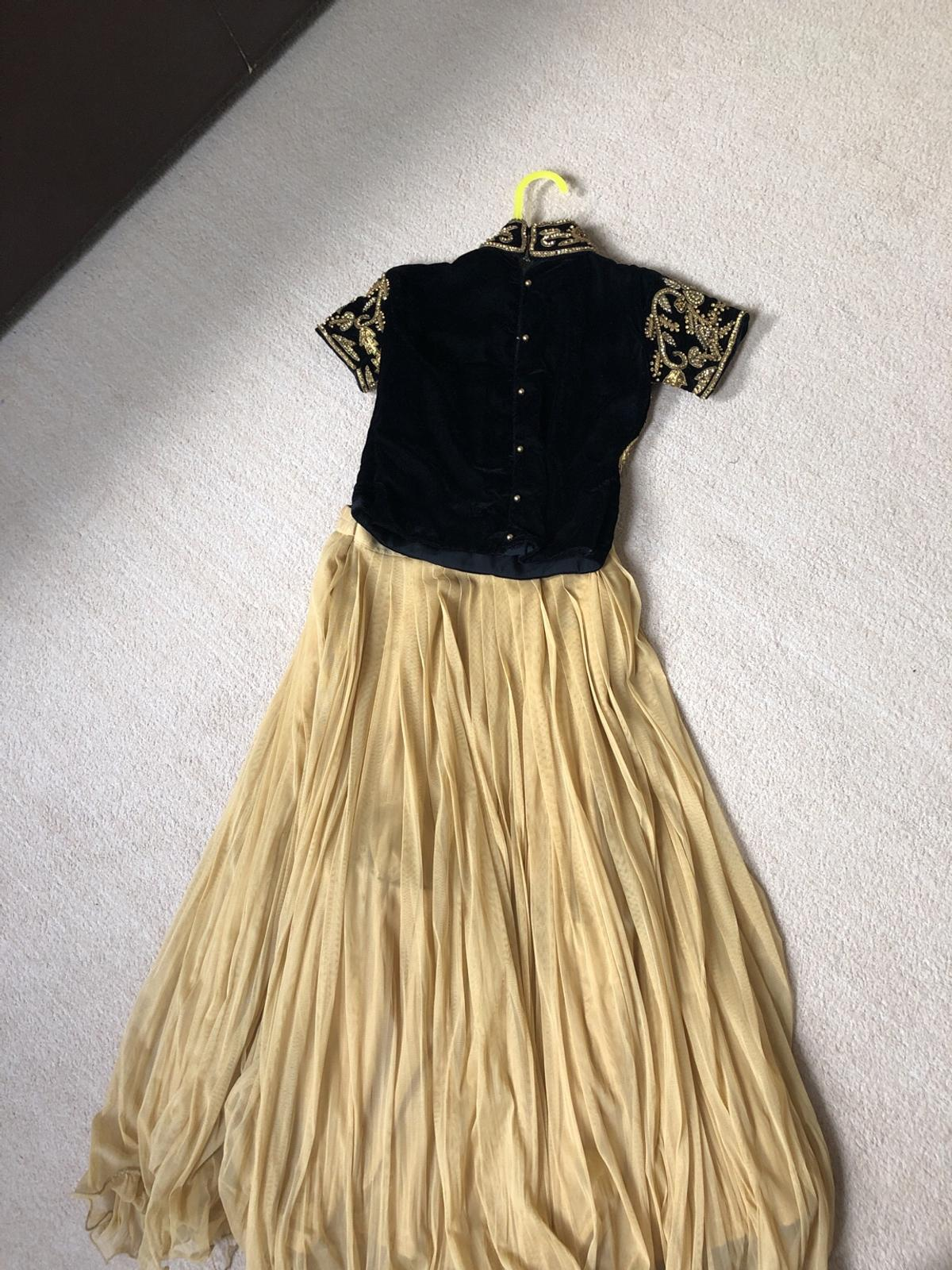 Black velvet top with gold embellishments Gold net skirt Good condition Size 26, would fit ages approx 8-10 Delivery extra