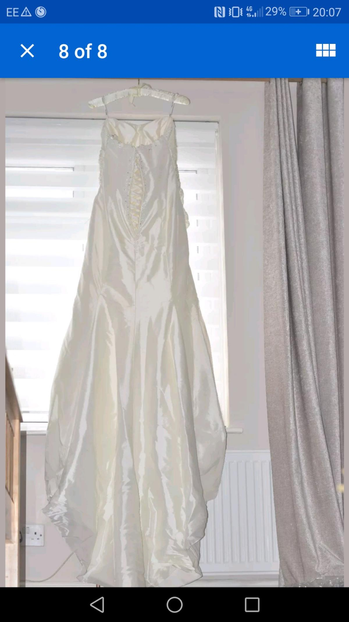 Wedding Dress size 18, Ivory, fitted with ruffles and jewelled embellishments, Lace up back and Puddle Train  Bought butchose another dress for my wedding. Requires a steam to remove creases. Very slimming shape and adjustable due to lace up. Collection only