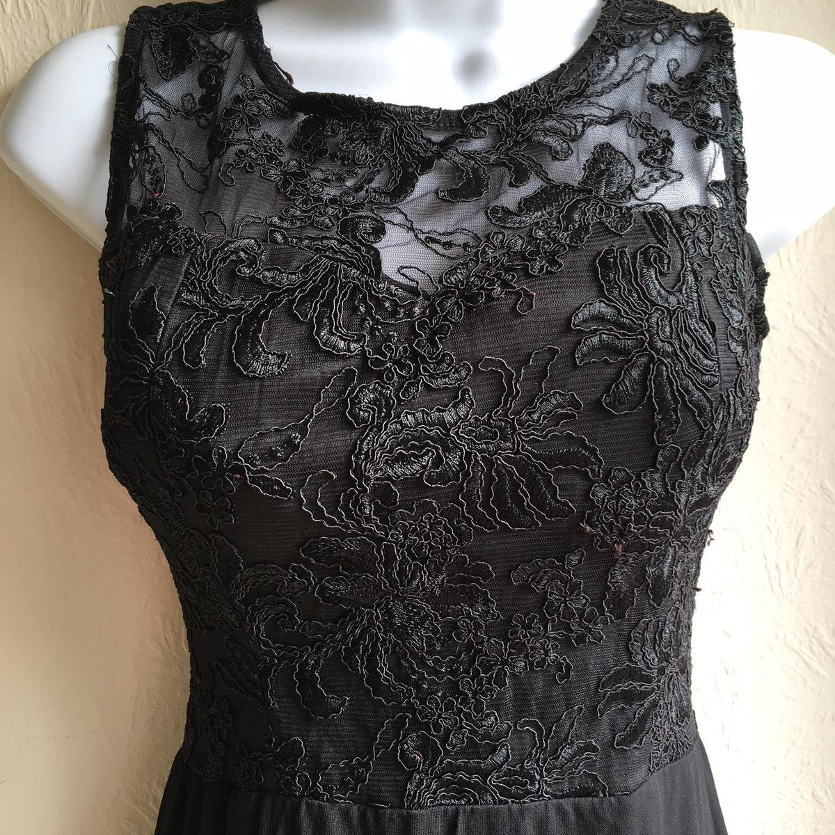 Fitted black lace bodice.  Fully lined, back zip.