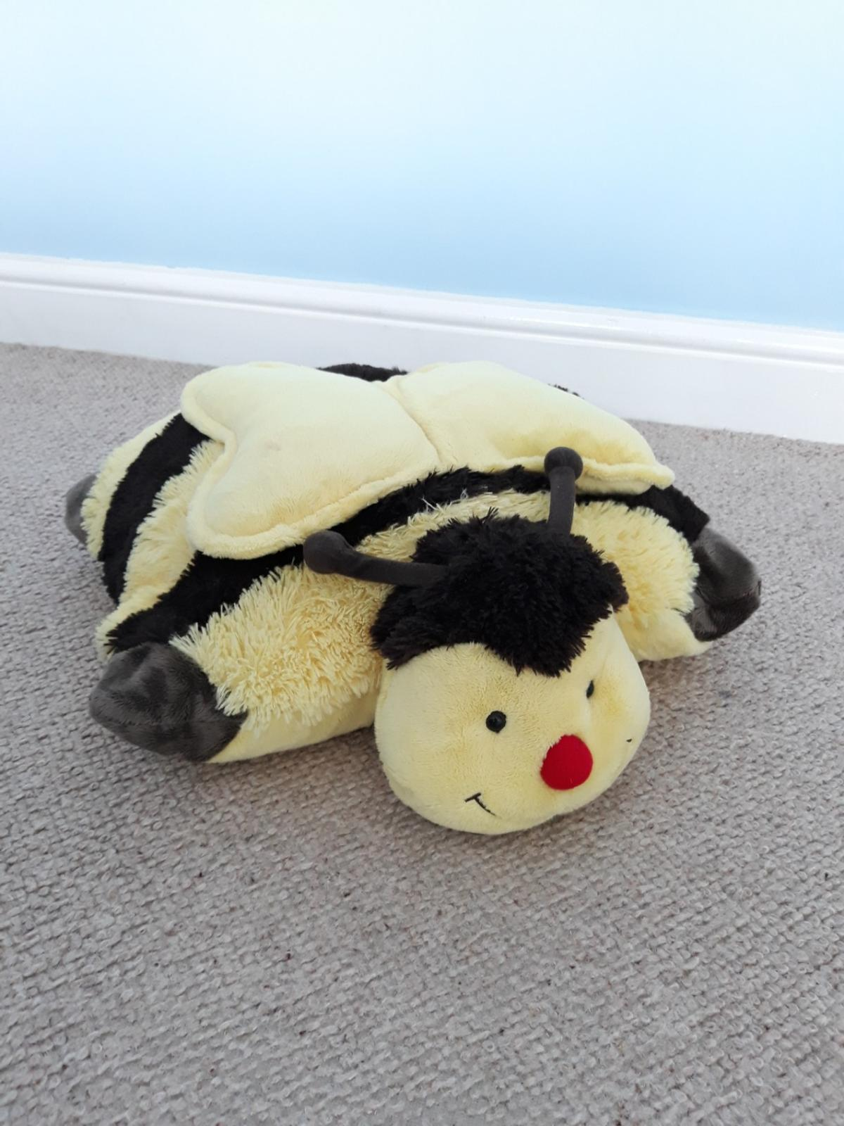 Pillow Pets bumblebee. Converts between a cuddly toy and pillow/cushion. Really snuggly. Never used as bought and forgotten about! Cost £10 and never used!