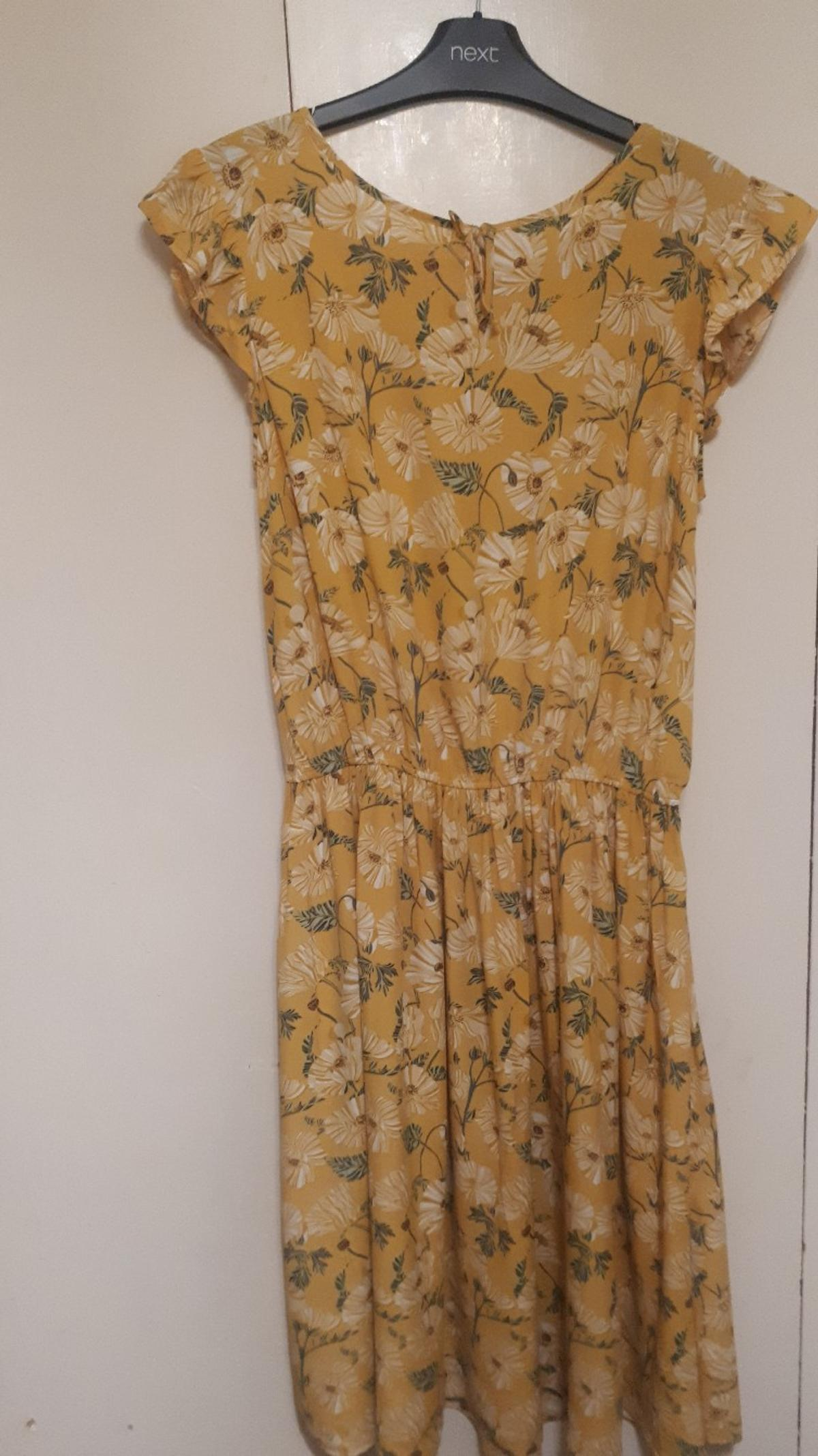 Girls' Next dress. Age 16, but may fit from age 12.  From smoke and pet free home.