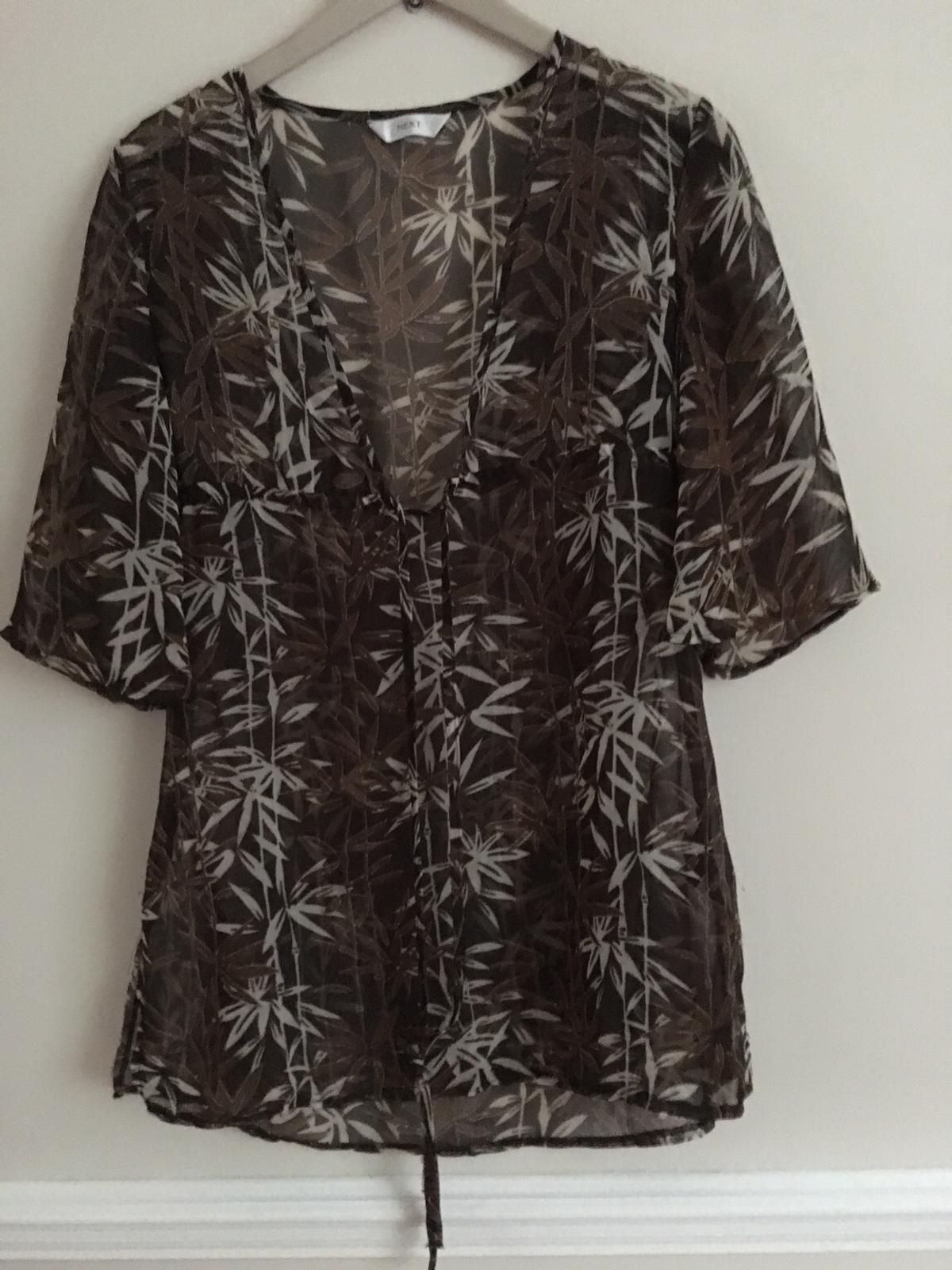Sheer cover up. Worn a few times. From a smoke and pet free home. Postage extra.