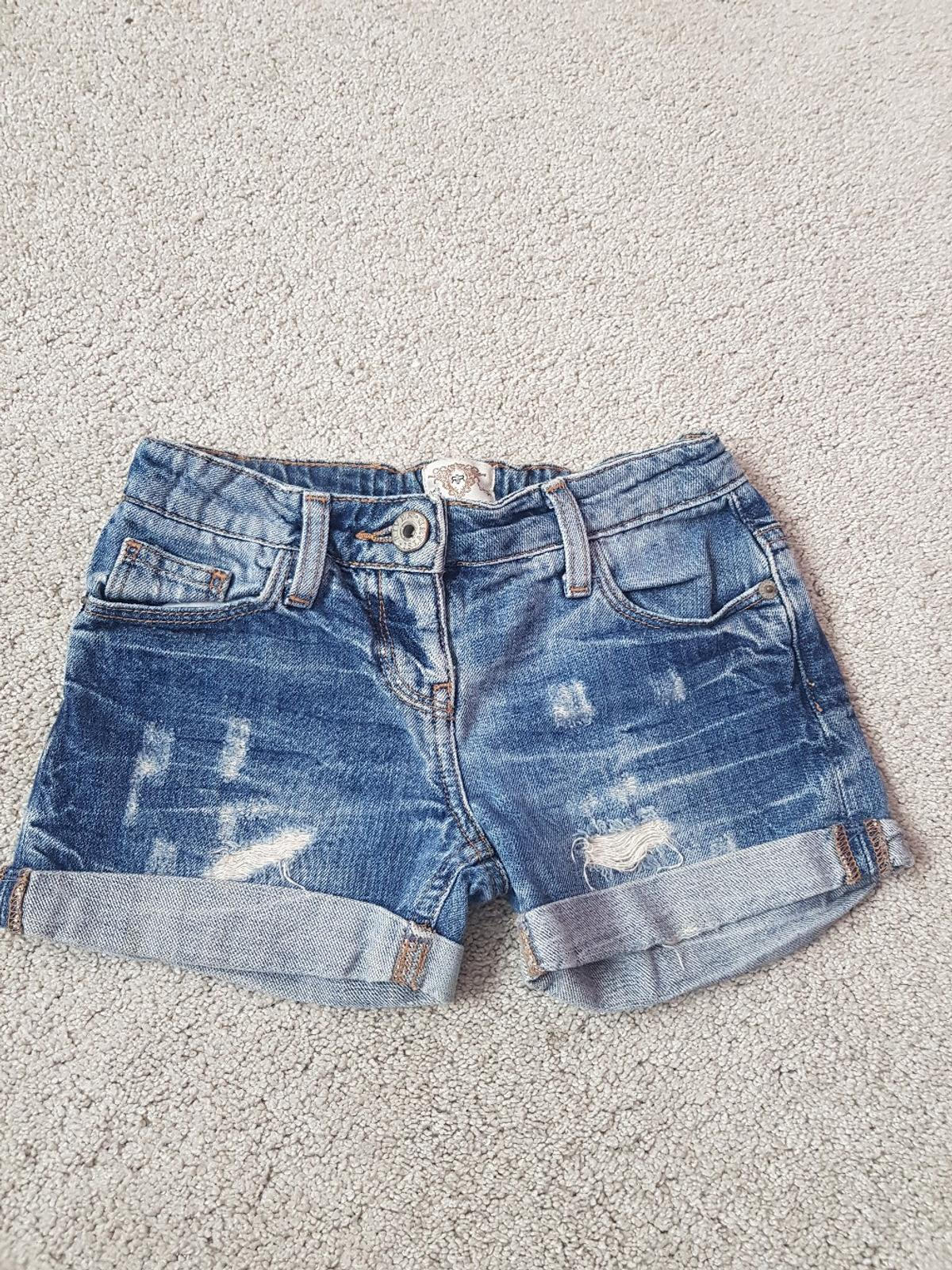 girls pretty denim shorts. from River Island. age 5-6years. sfs