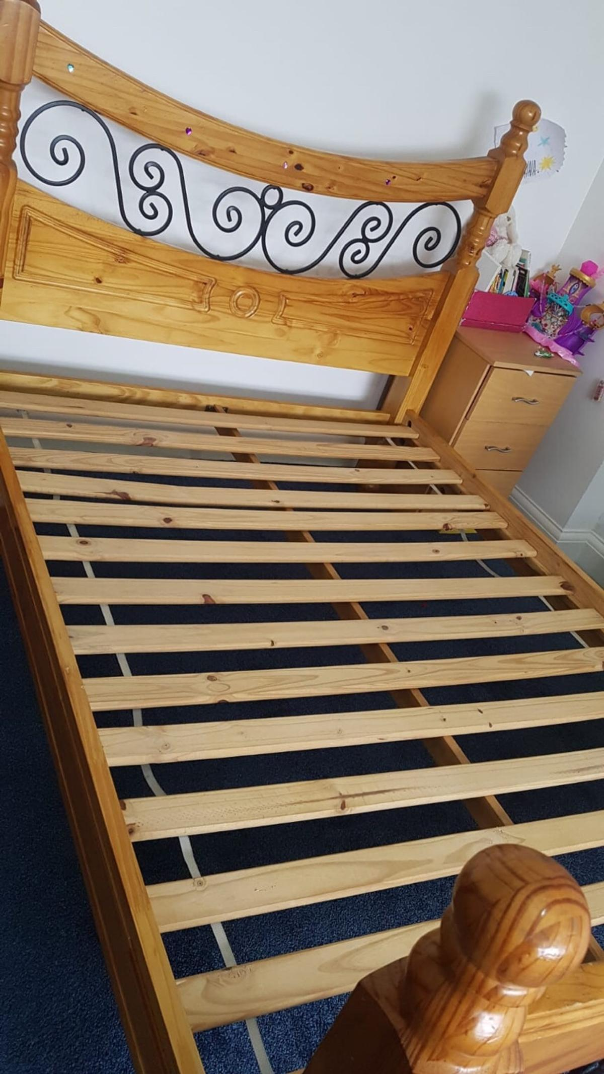 A beautiful double solid pinewood post bed frame with metal spirals in immaculate condition minor scratches but nothing major shows all in pic how bed looks  Slates in perfectly good order extra storage space under bed it' can store suits cases under bed too and under bed storage boxes too Was £300 now on sale for £250'grab a good bargain clearing out my furniture