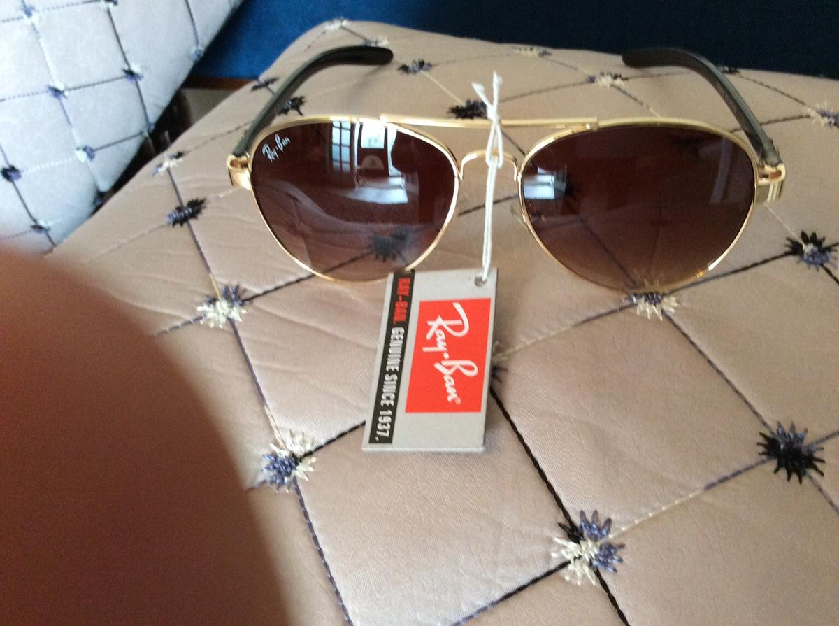A exclusive pair of ray ban sunglasses coded with all the colours black and gold hurry posting On this site four 4days so please grab a bargain for 3 days