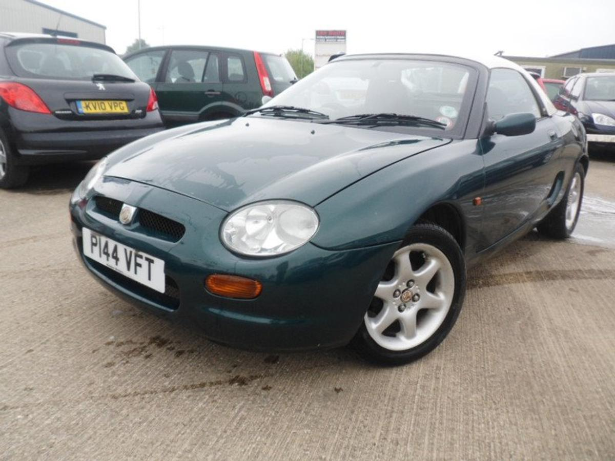 1996 MG F, £1495 - 10 % SALE = £1345, Sports car, 1.8 Petrol, Mileage; 83,130, Sold with full 12 months MOT, 8 previous service stamps, Sold with full service inc. new cambelt if applicable, Sold with 3 months warranty, Road tax; 6 months @ £140.25 or 12 months @ £255.00, MPG; 38.2, Power; 118 bhp, Transmission; Manual, Colour; Green, Previous owners; 3, Keys; 2, Special features; * Hard top, * Original handbook, * Remote central locking, * CD/radio player with CD changer in boot, * Seat armrests, * Cup holders, * Height adjusters on headlights, * Dual front SRS airbags, * ABS anti lock breaking system.