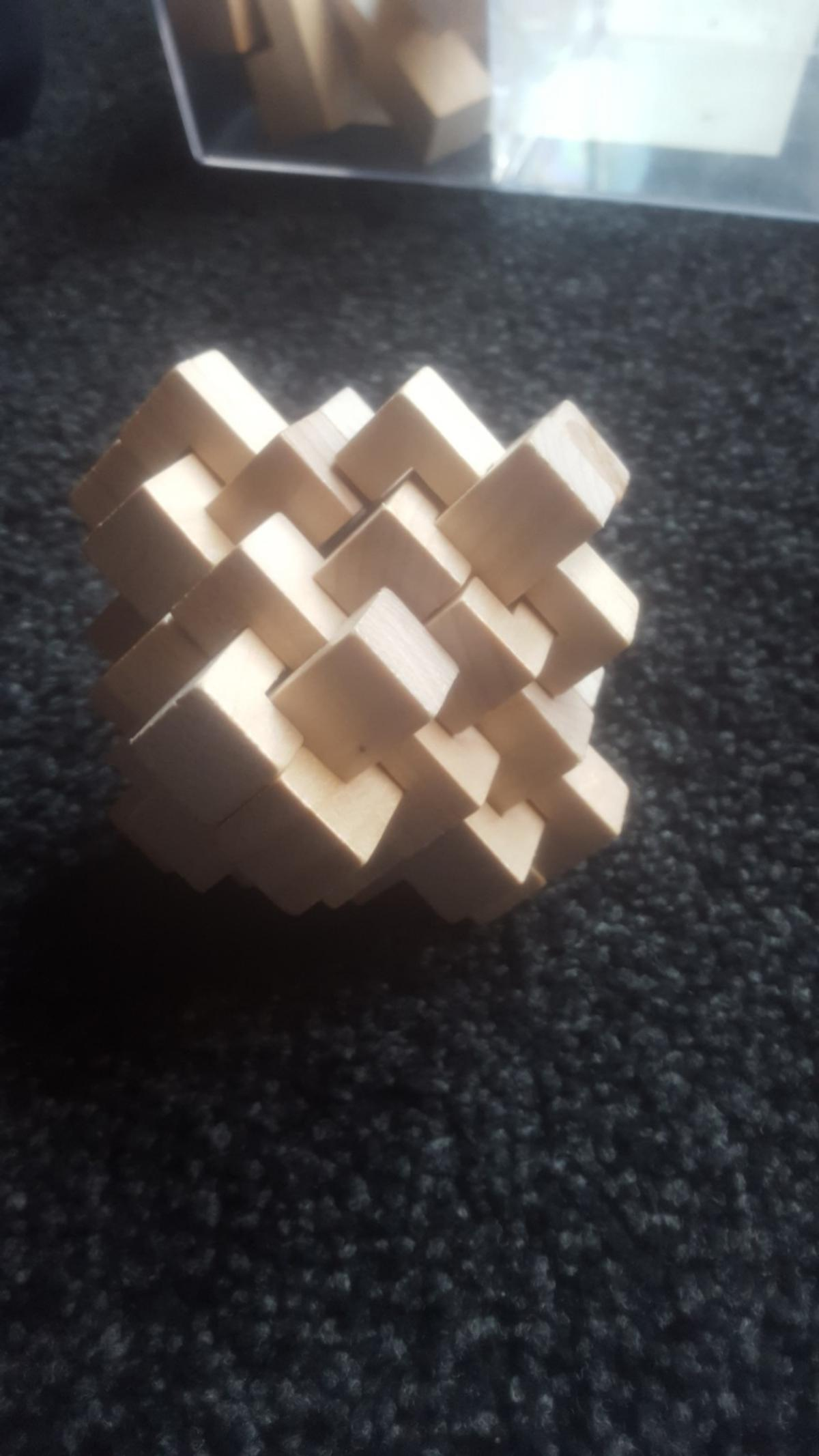 4 solid wood puzzles and instructions and good luck to you on them perfect for xmas gift
