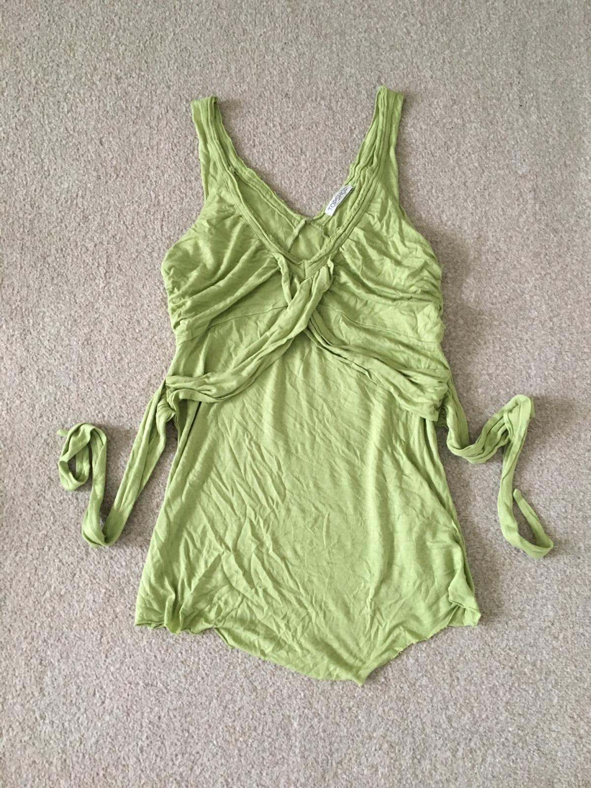 Green wrap vest cami top  Been vacuum packed so needs to iron otherwise in perfect condition  Size 10