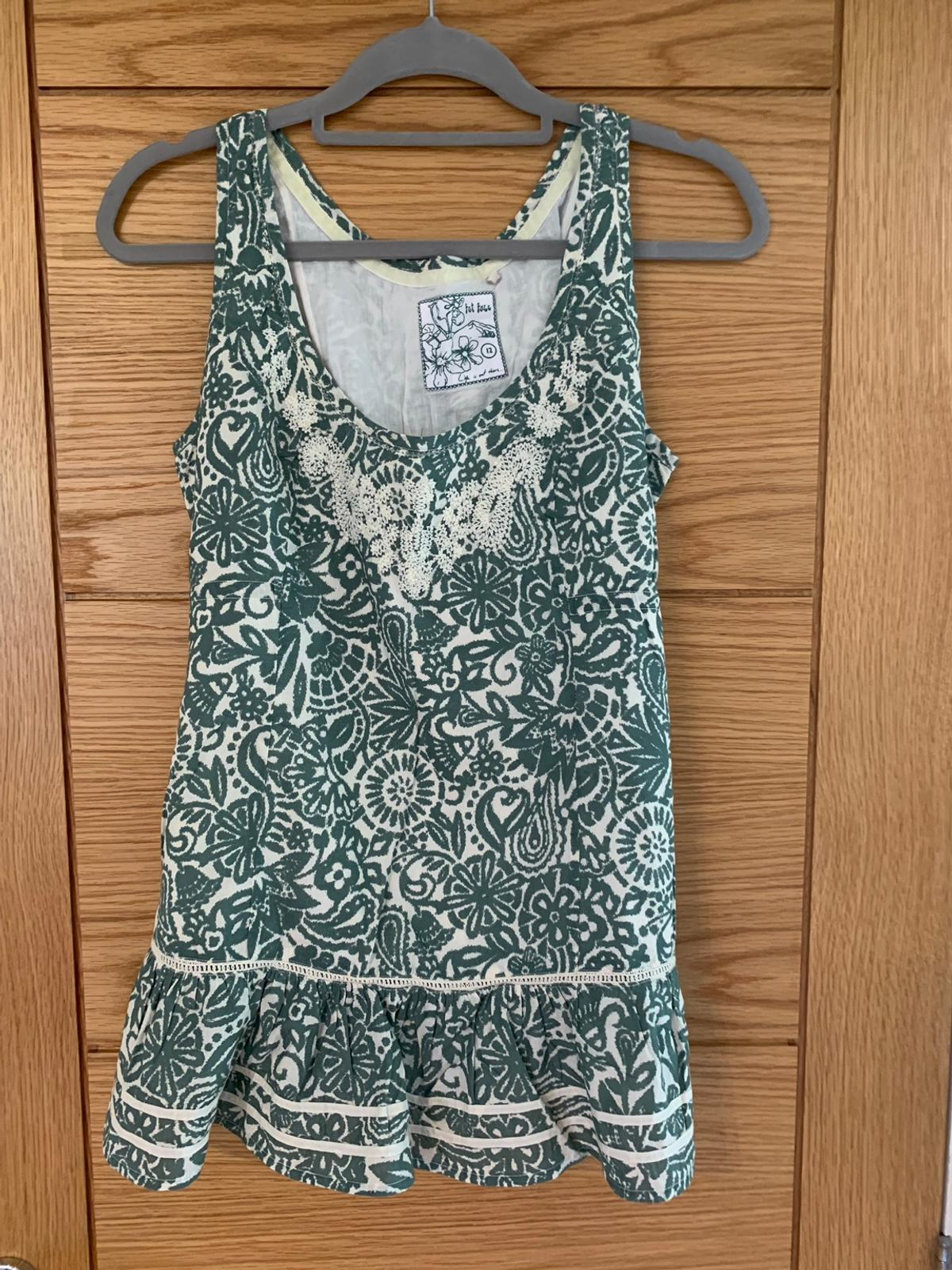 Excellent condition, only worn a couple of times. lovely pattern with tie back. From smoke and pet free home. Please see other items that I am selling as we are having a huge clear out.