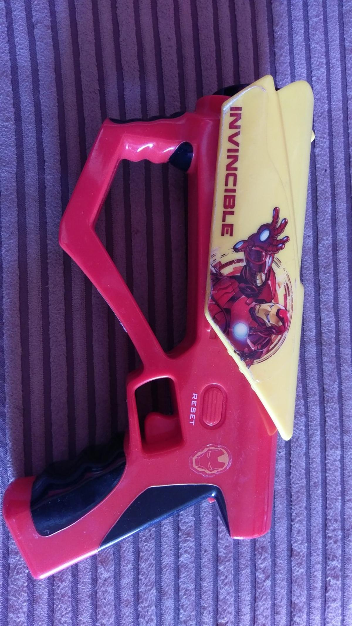 Kids Marvel invincible iron man ,lighting, sounds toy gun. It's is in excellent working condition.