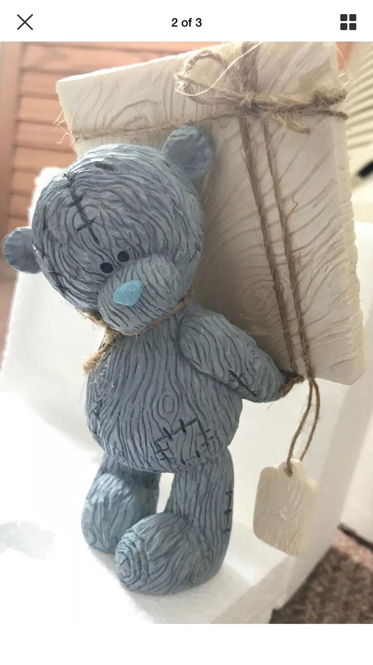 I am selling a tatty teddy bear holding a parcel. Brand new, still has original packaging. Only been opened to take photos! Open to posting with the cost of £4.95 Royal Mail 2nd class signed for!