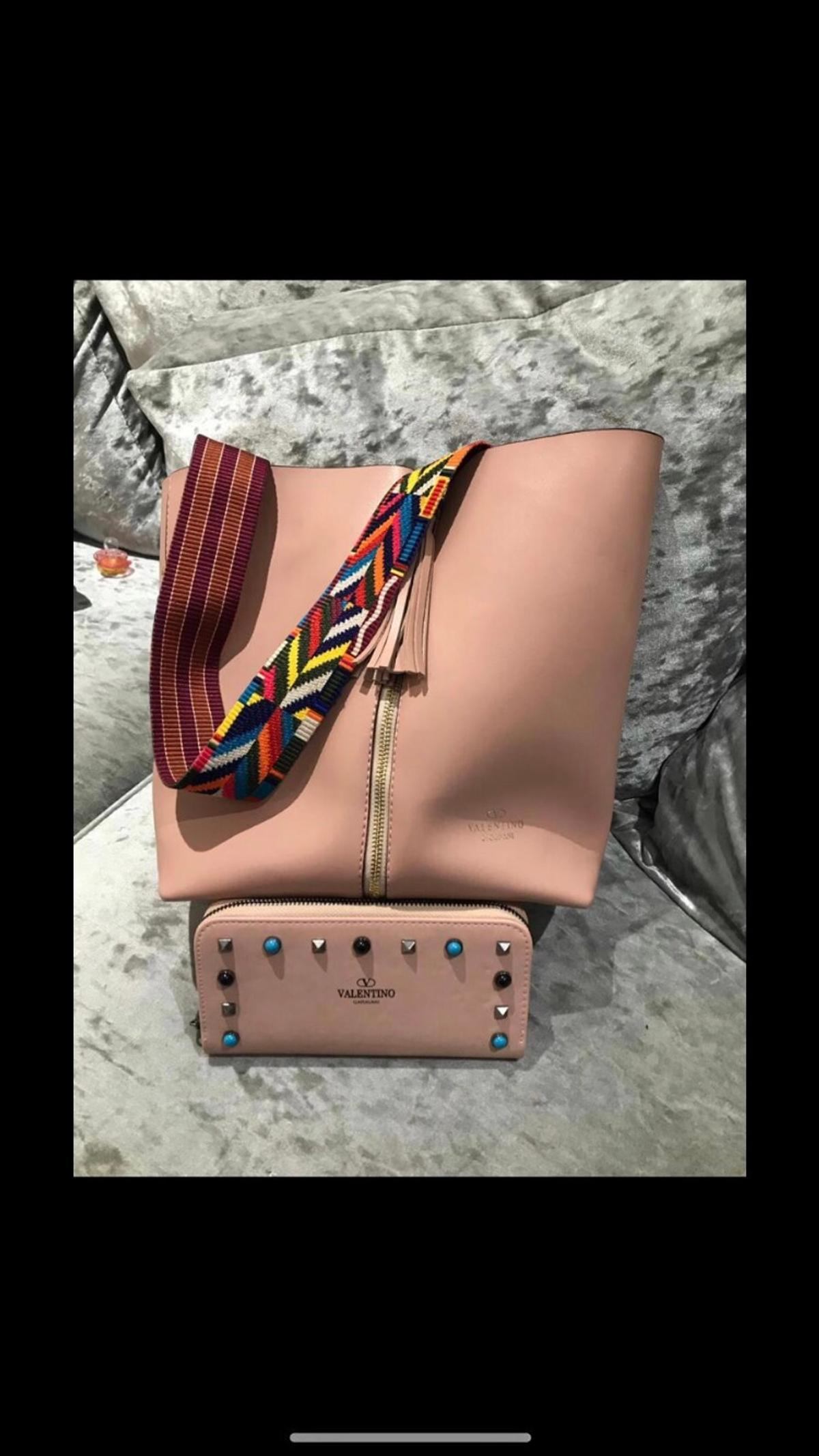 Brand new Hand bag comes with matching clutch bag and matching purse Main hand bag has a couple of marks,hardly Recognisable