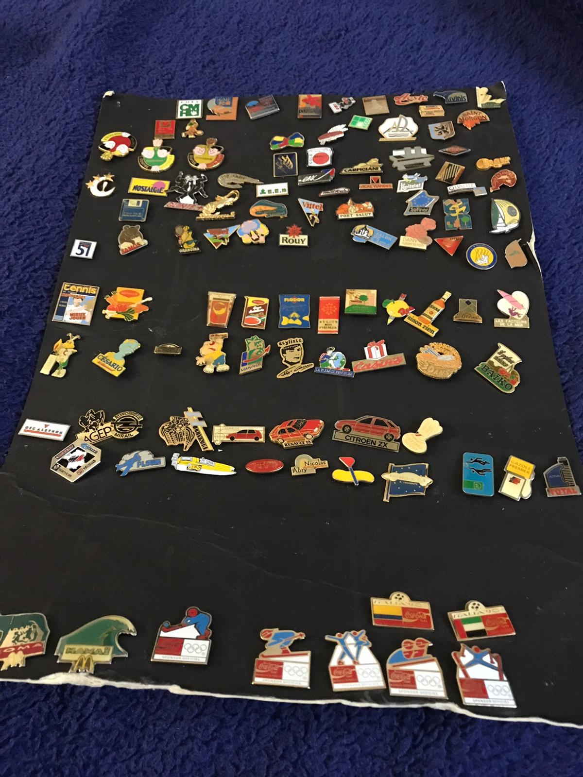 Over 100 enamel pins. Most with backs.