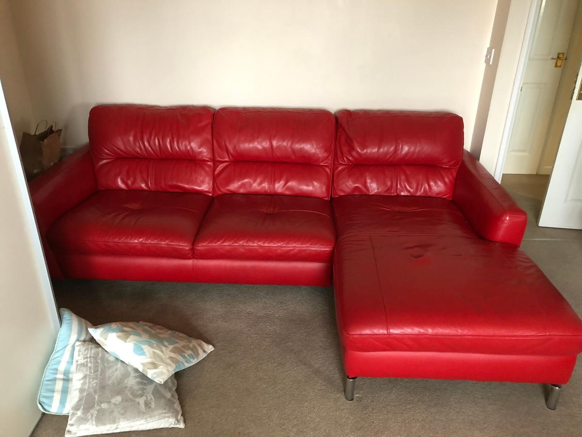 Red leather corner sofa, very good condition.