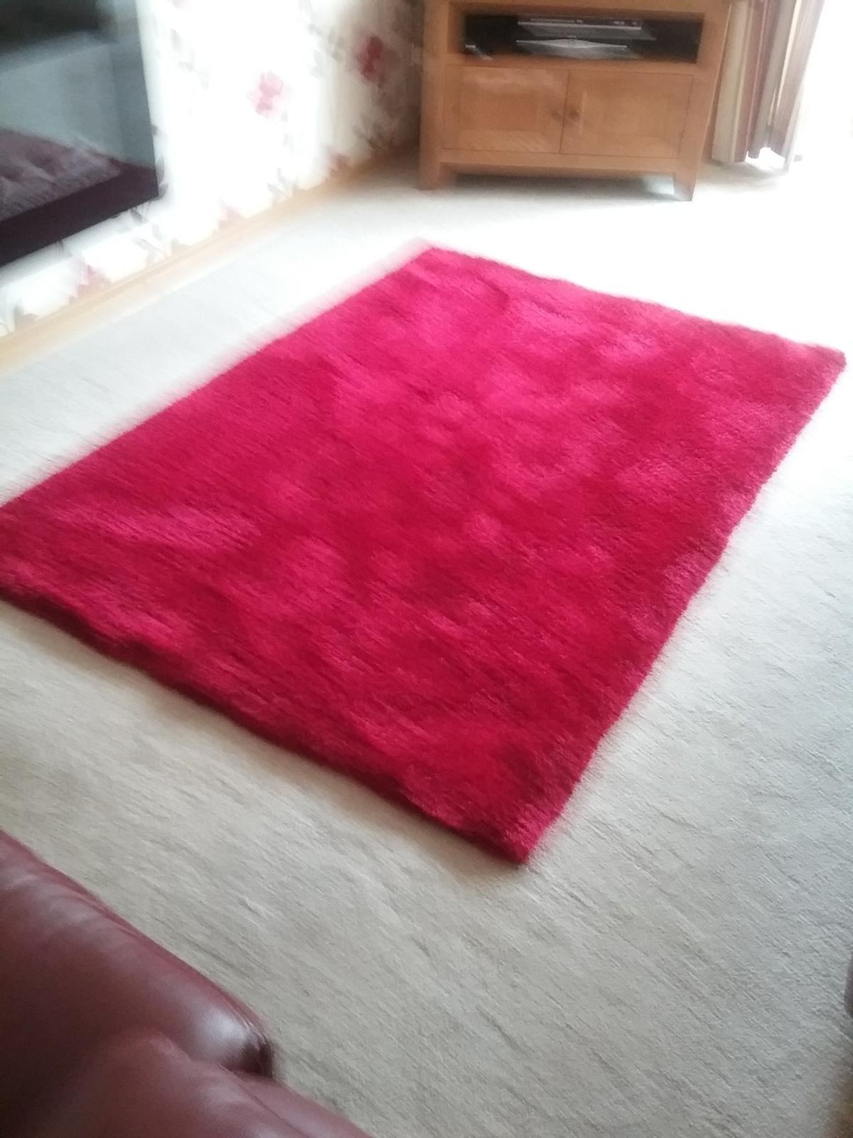 red long pile rug. 120 x 170