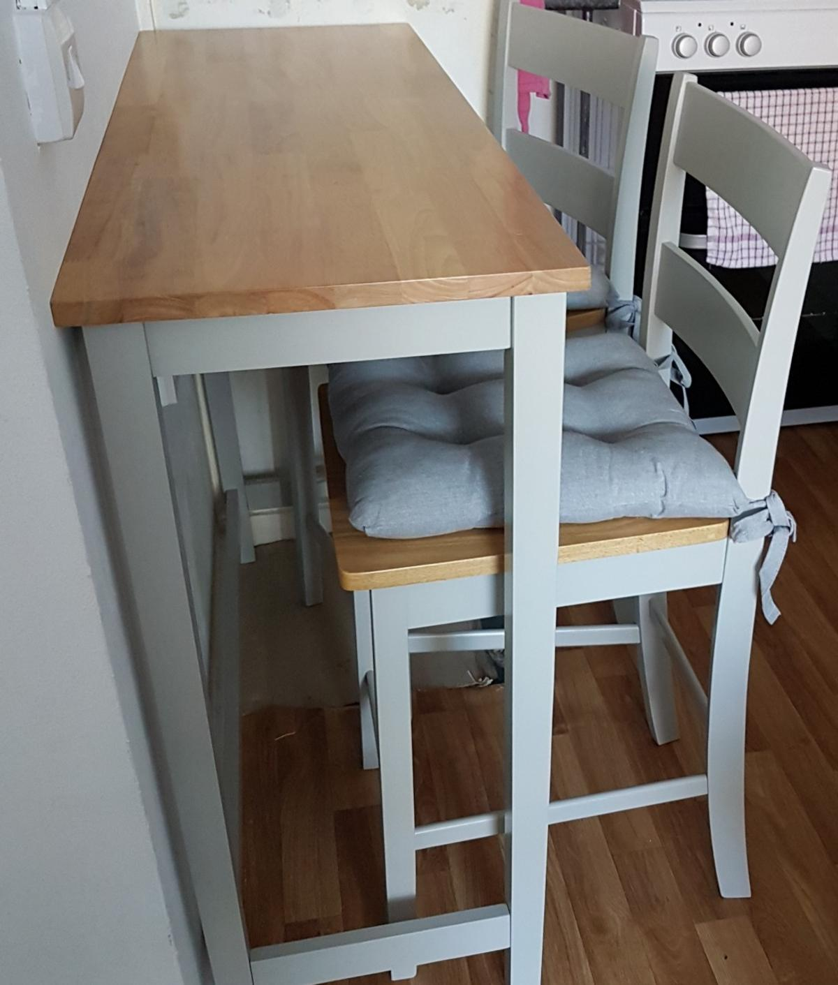 Breakfast bar and stools, with seat pads. in Hertsmere for £9.9 ...