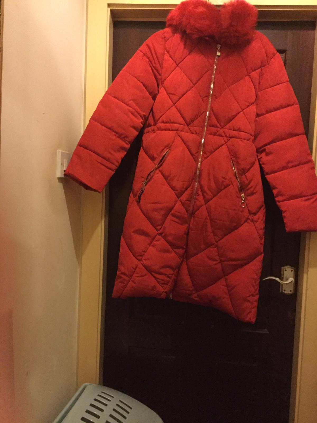 69aa9a511 Long red bubble coat size 14s