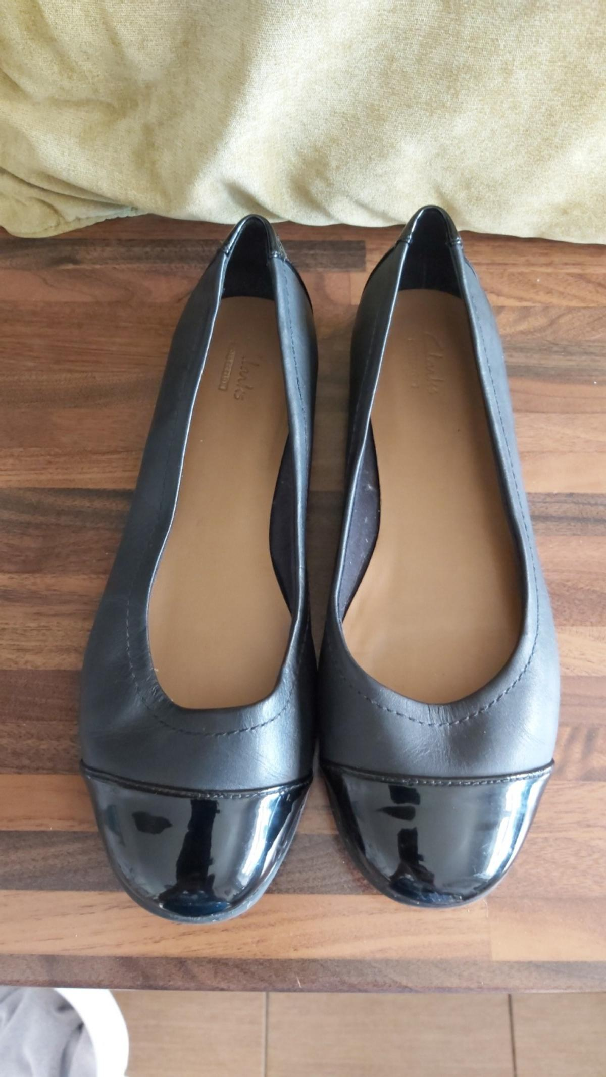 Clark's slip on shoes Black size 7 worn once £10.00 No Lower. pick up only.NO LESS. Very good condition.
