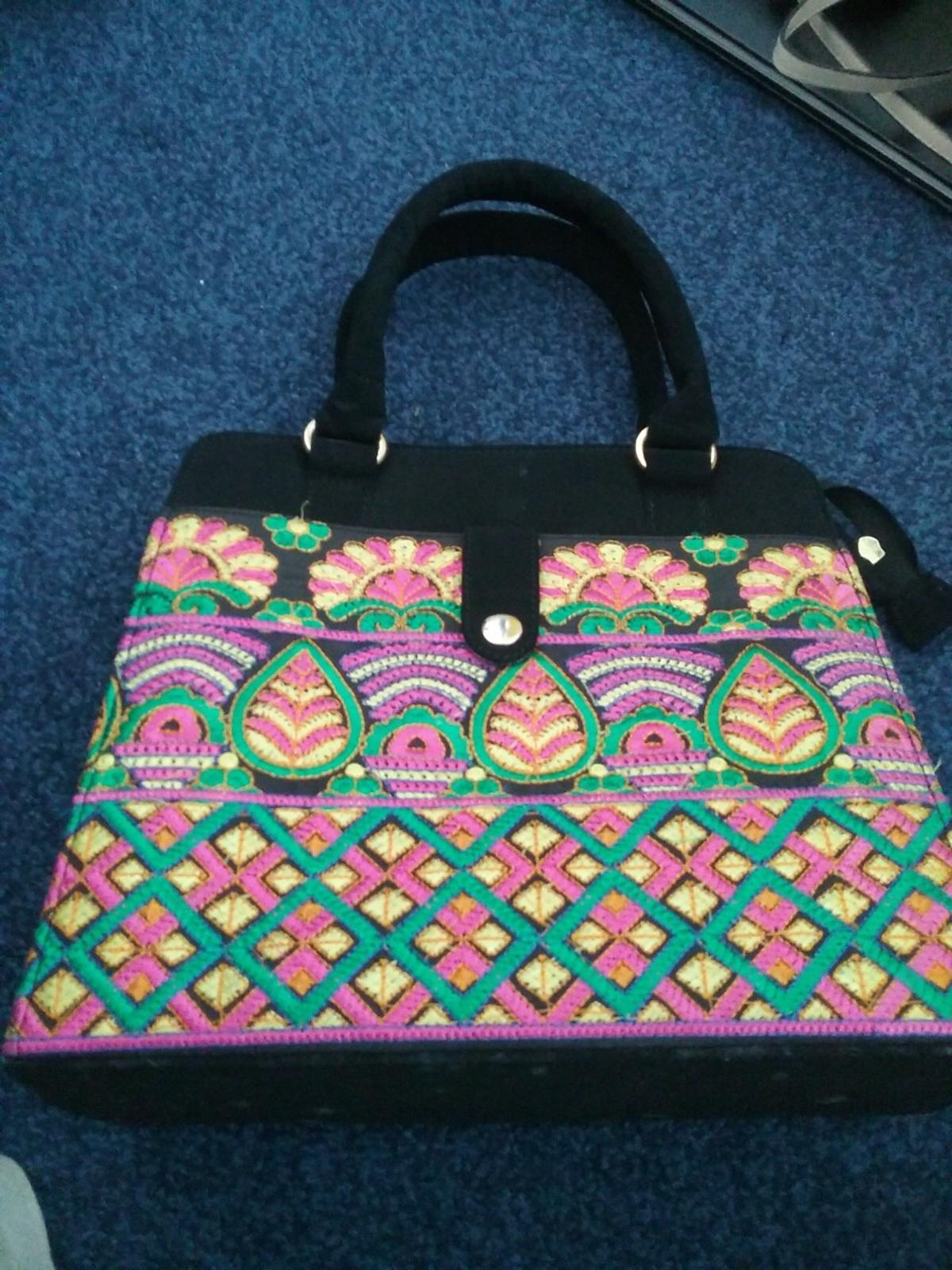 Used once  black velvet with multicolored embroidery  ideas by gul ahmed  gorgeous handbag