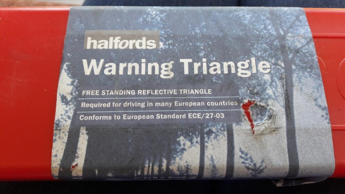 free standing reflective triangle packs away into plastic box required if driving in France