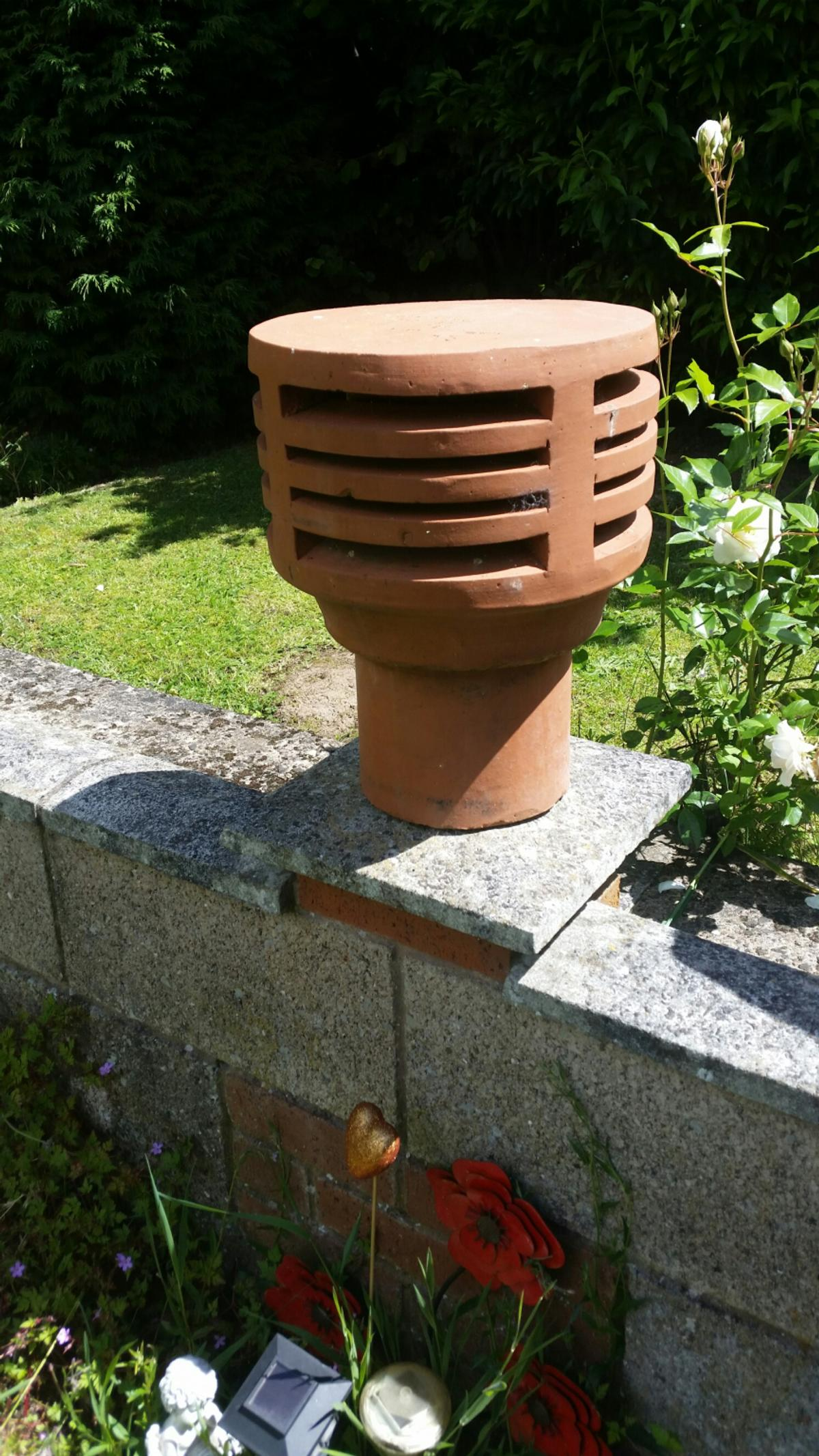 Tericota chimney pot never used could be a garden ornament, or upside down a plant pot, or for the real thing even. got to go.
