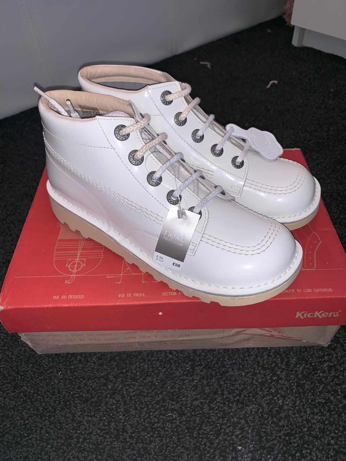 WHITE BRAND NEW KICKERS STILL WITH TAGS SIZE 6