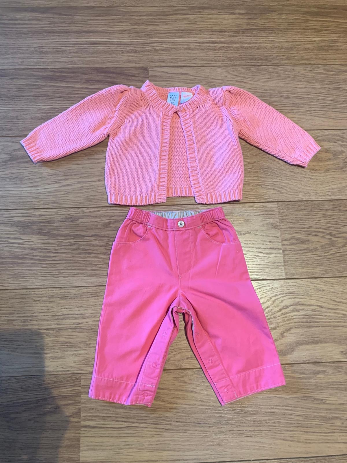 Trousers have poppers down inside legs for easy nappy changes. Excellent condition. From smoke and pet free home. Please see the other items that I am selling as I am having a huge clear out.