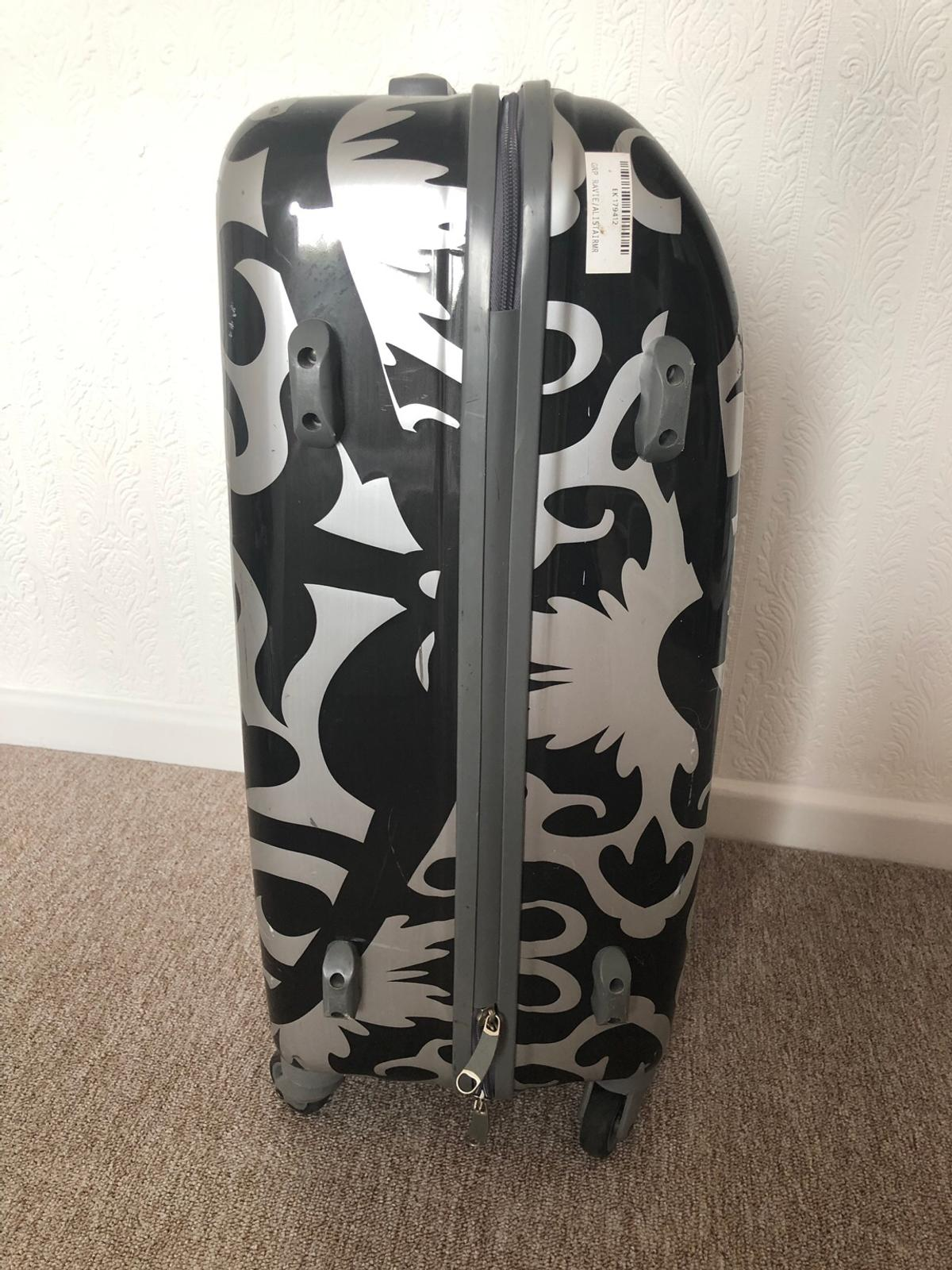 Hard casing, marks/ scuffs and stickers but no damage or holes. Number lock code, 4 wheels, handle and extendable pull out handle.  Height 65cm Width 42cm Depth 22cm