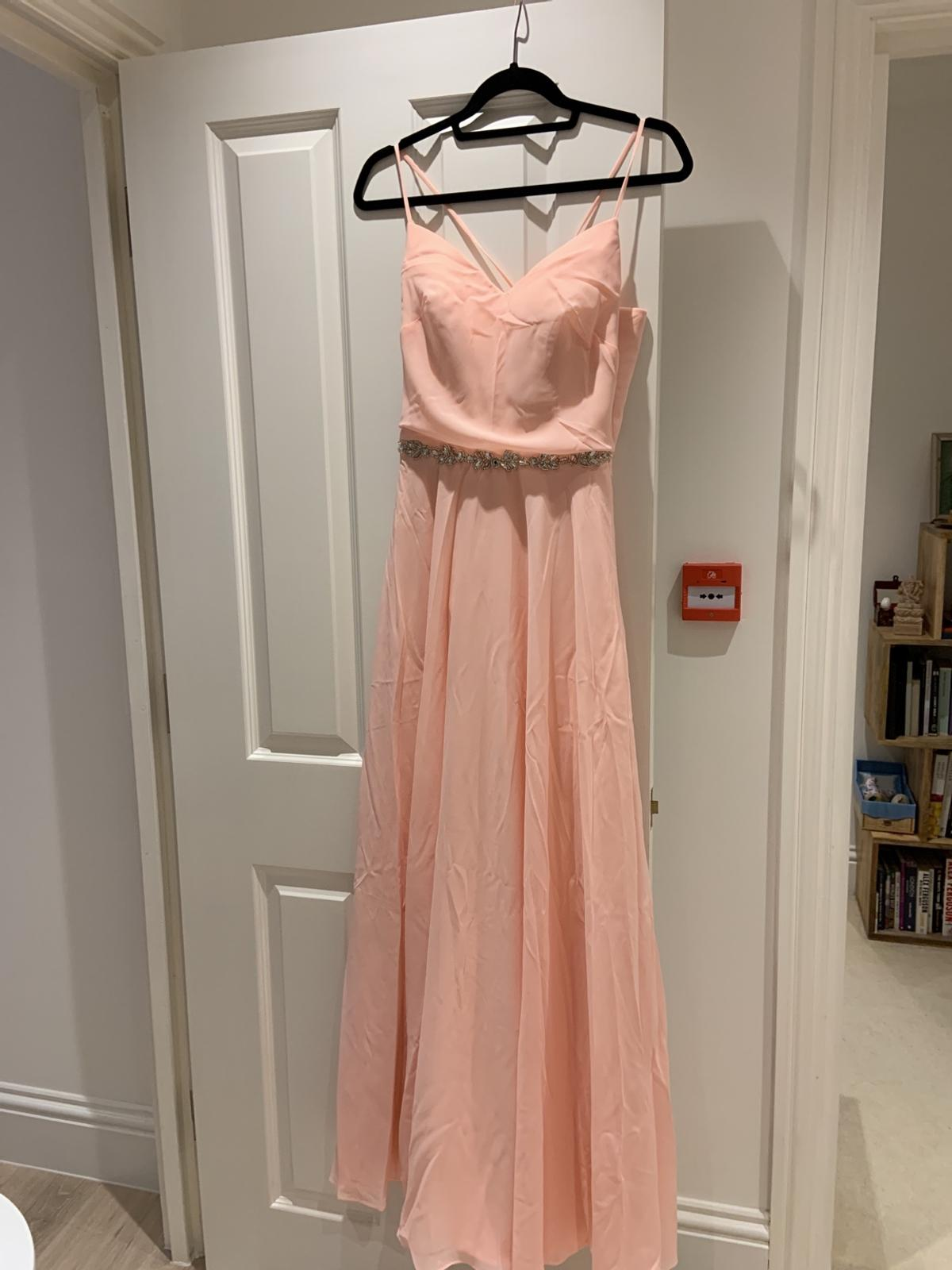 A brand new beautiful peach maxi dress with beaded belt detail, UK size 10-12. Never worn, labels still attached. comes in original packaging and with spare beads.