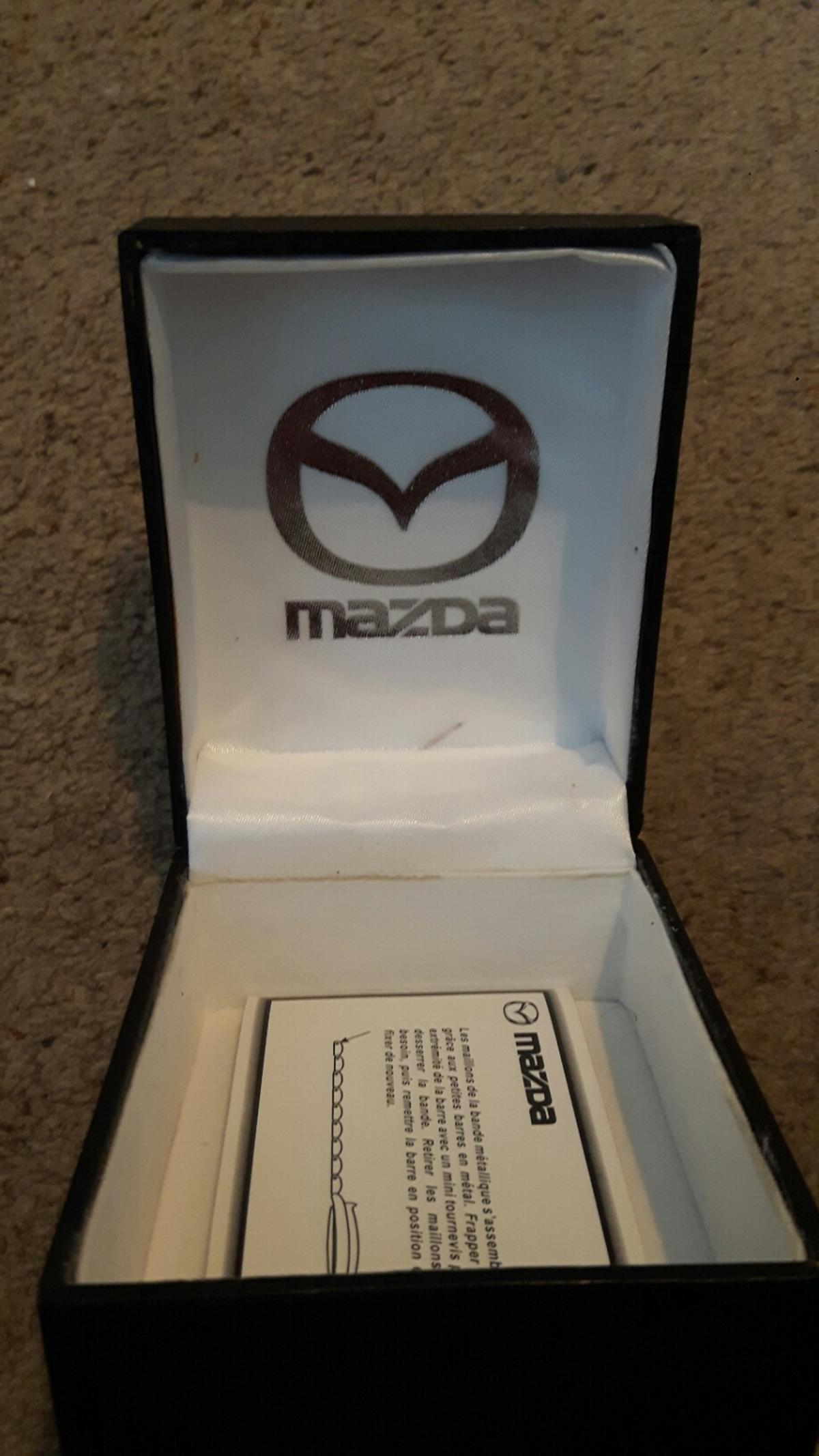In box in excellent condition ladies Mazda watch no scratches on face none smoker no pets good condition needs battery.