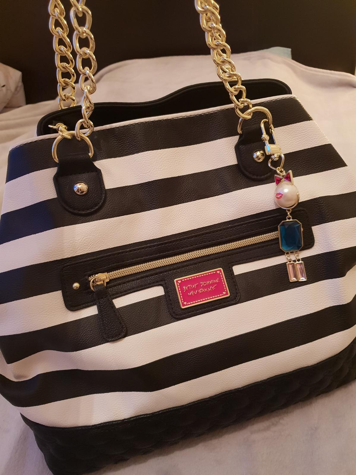 """Large Betsey Johnson Bag With cat charm & make-up purse. Brand new. Never used. Betsey Johnson XL Black & White Stripe Tote Bag Bag is 13.5"""" tall, 13"""" wide, 8"""" deep Zip and slip pockets inside. Made of polyurethane.  PLEASE CONTACT ME IF YOU HAVE ANY QUESTIONS"""