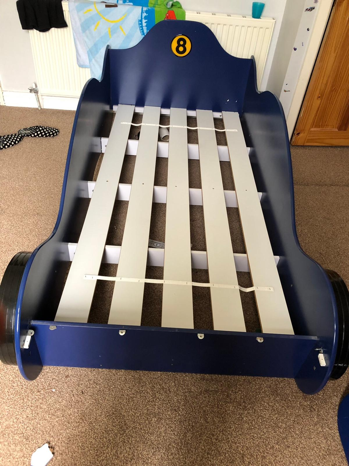 A boys single car bed, been used but well looked aftered and maintain, comes from a loving home