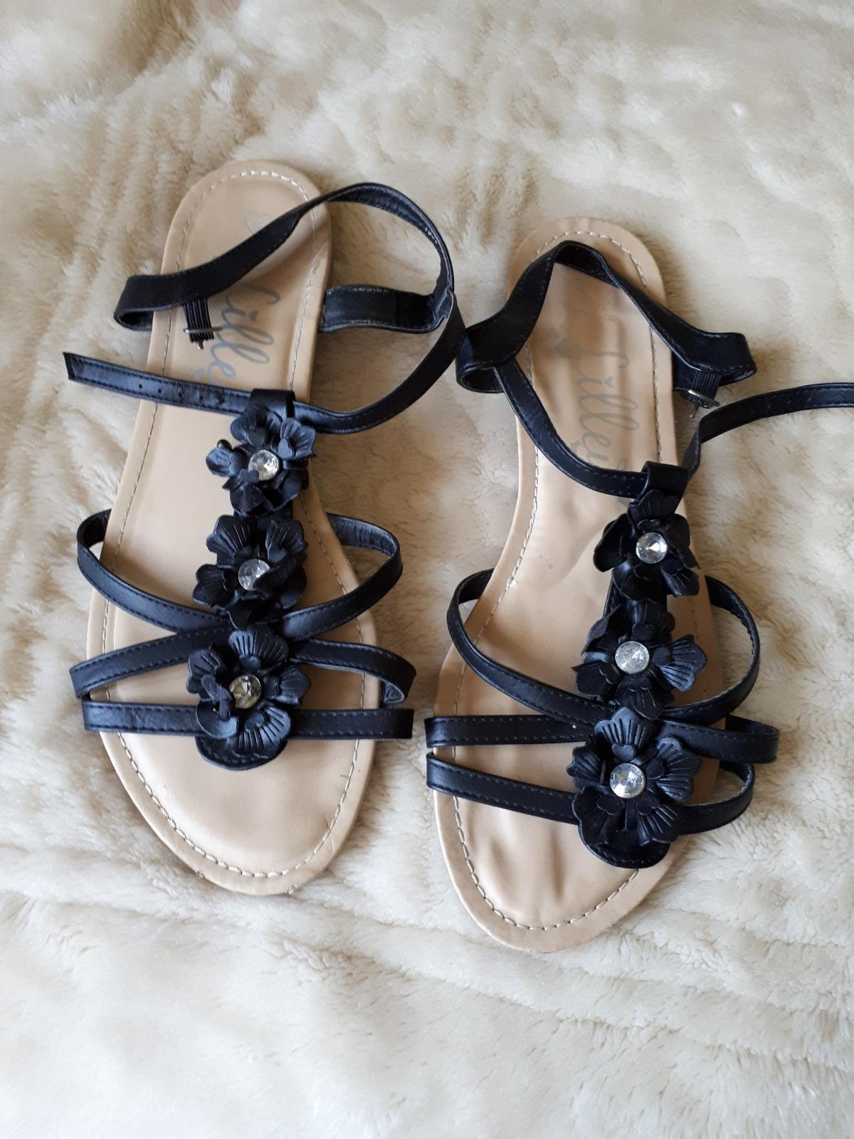Very comfy black flat sandals with 3 flowers up the front and crystals. I thought they were big on me then I realised I had looked at the size upsides down and I wanted a 6