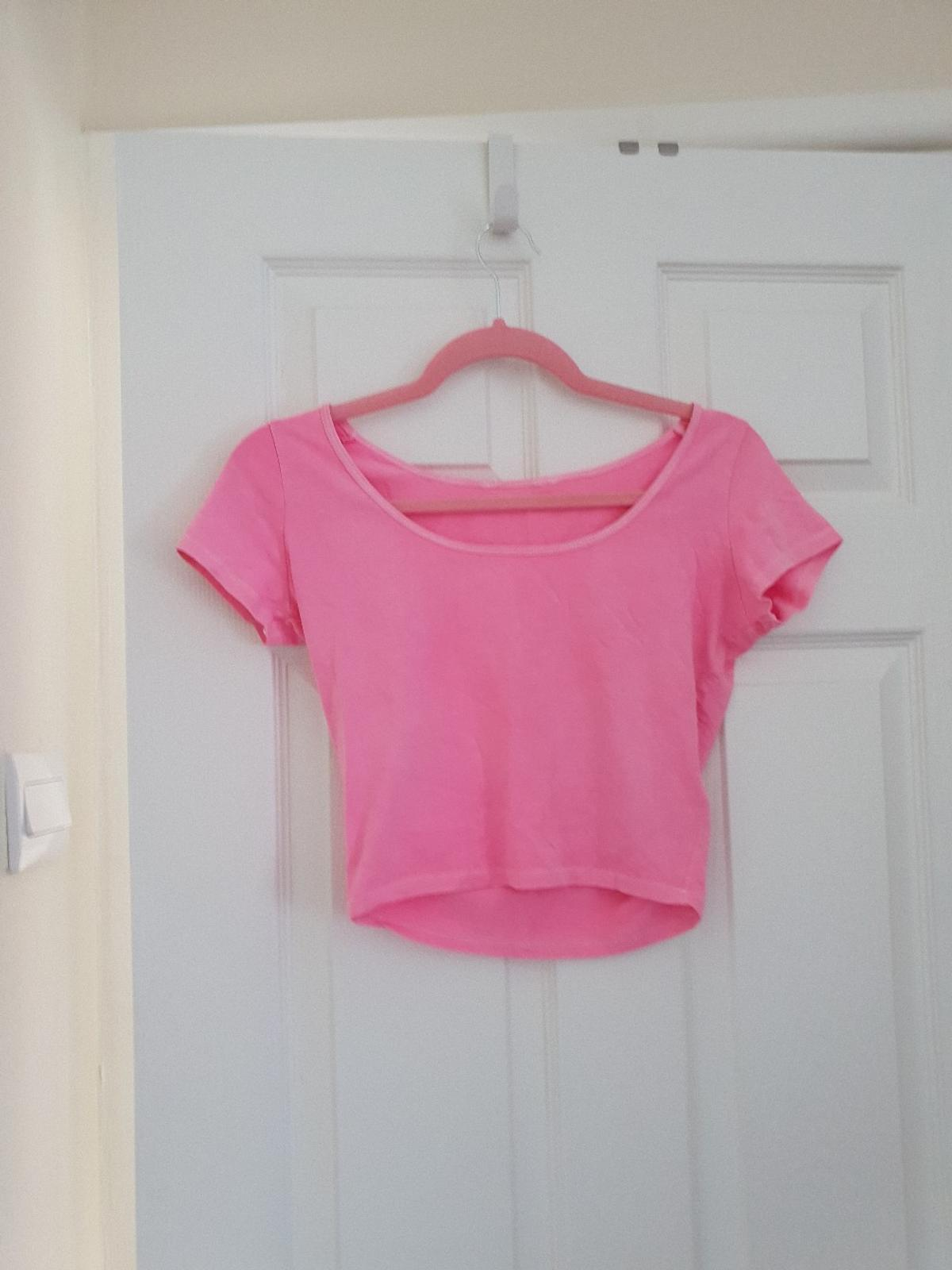 Size 8 pink crop top from New Look. Collection only from Aldridge WS9.