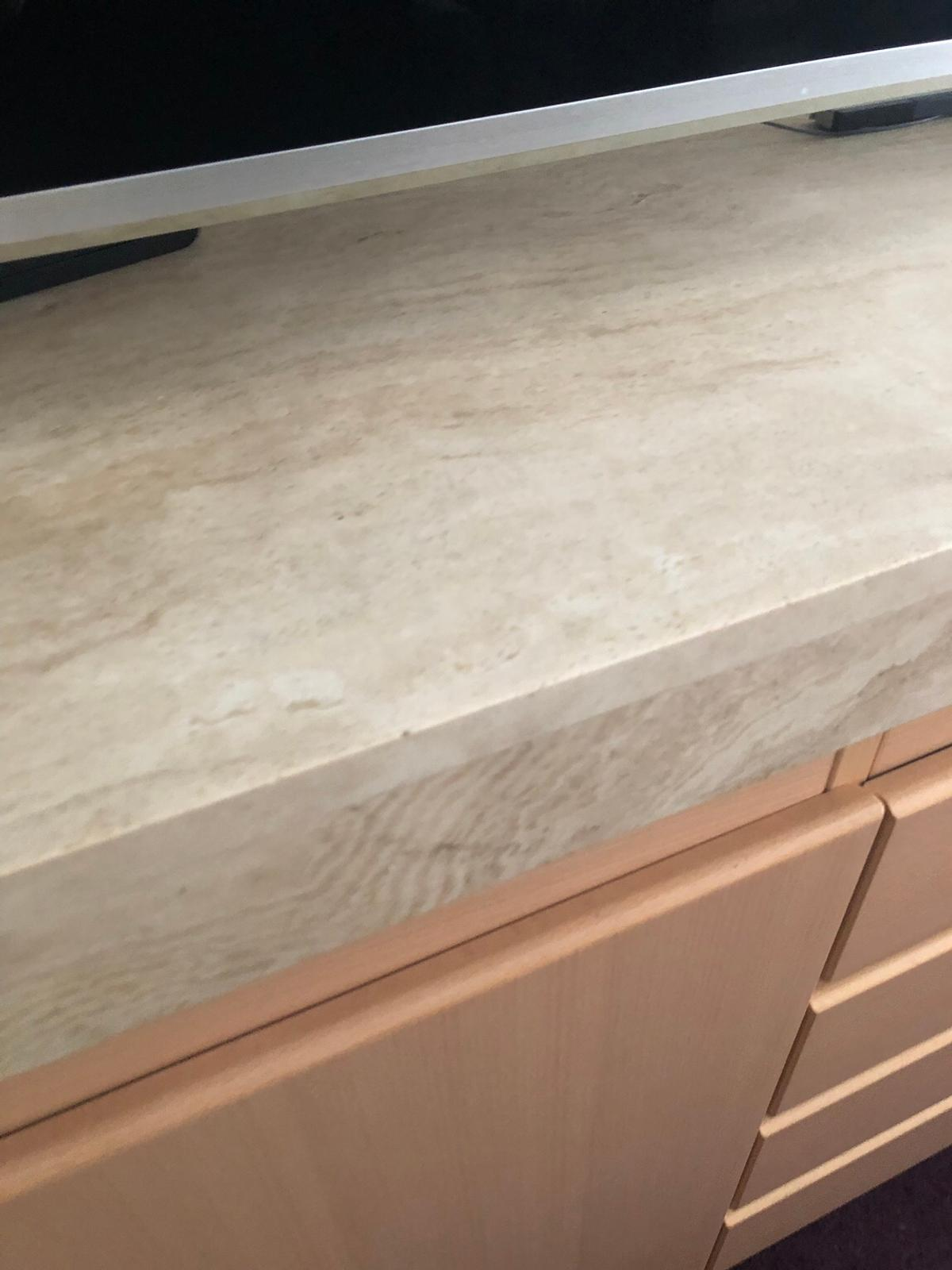 Maple/beech 2 door 4 draw sideboard. Solid Marble top really heavy. 2 man to be moved excellent condition.