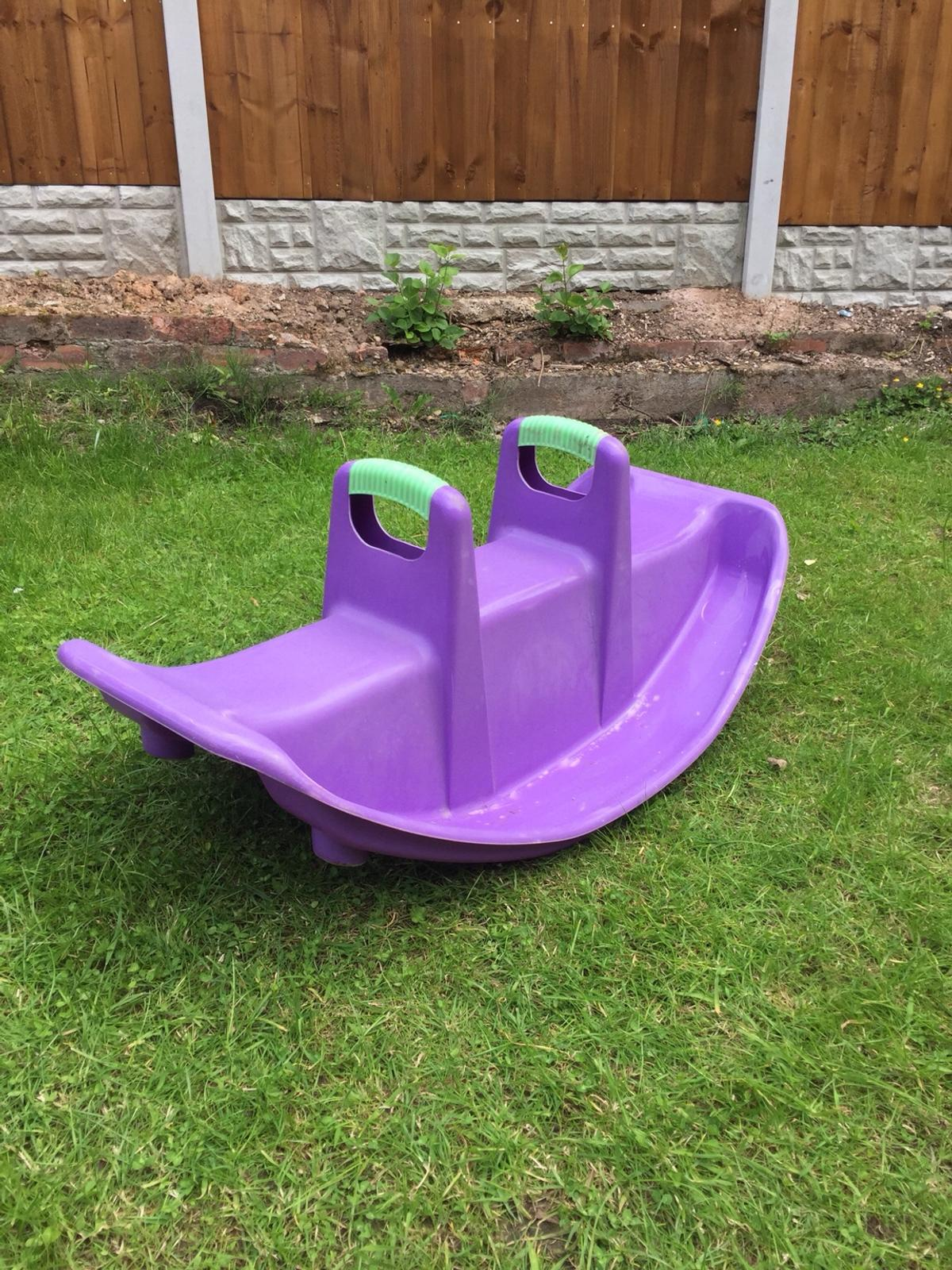 Child's plastic sea-saw. Great for the summer in the garden. Weather durable. Good condition.