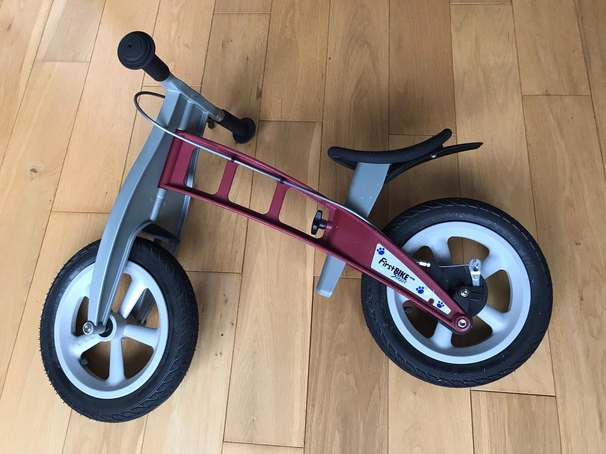 Children's Balance Bike FirstBIKE - red  This is truly the best balance bike for kids to move straight to cycling a normal bike without stabilisers! Needs a good clean and has some white marks but mechanically is in excellent conditions as you would expect from a German product.  Plenty of life still in it as gently used!