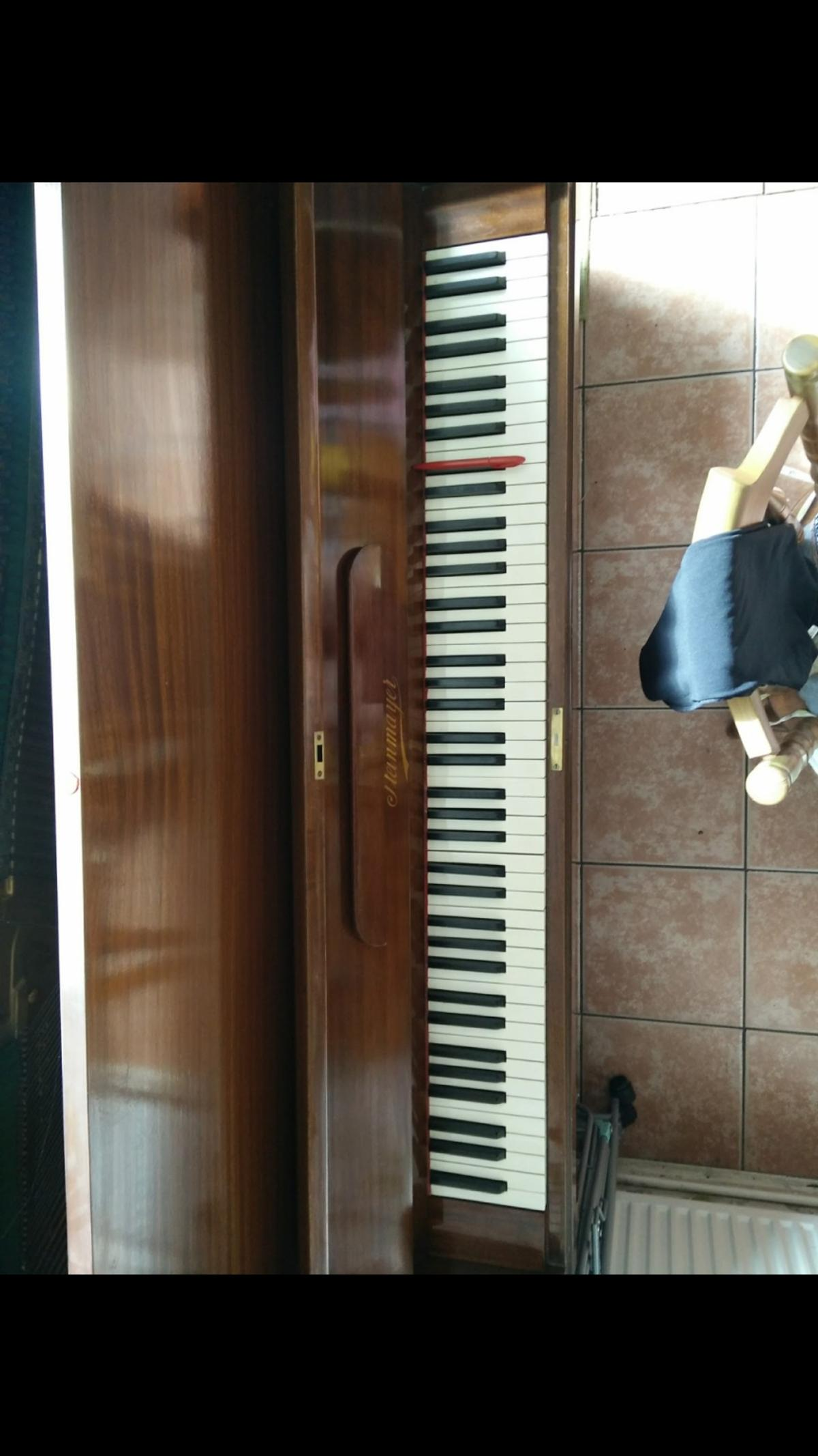 Acoustic piano has served many happy years of playing but I have bought an electric one.  Needs a little TLC, the image with a red pen on the key needs a replacement hammer.  Piano is in the N19 area  Collection only!!