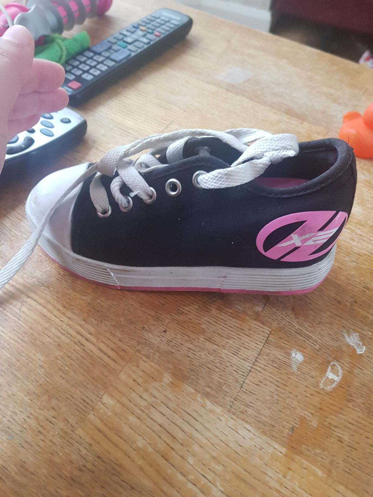 size 12 girls excellent condition. heelys shoes with wheels. originally for £50. kids love them will never take them off lol