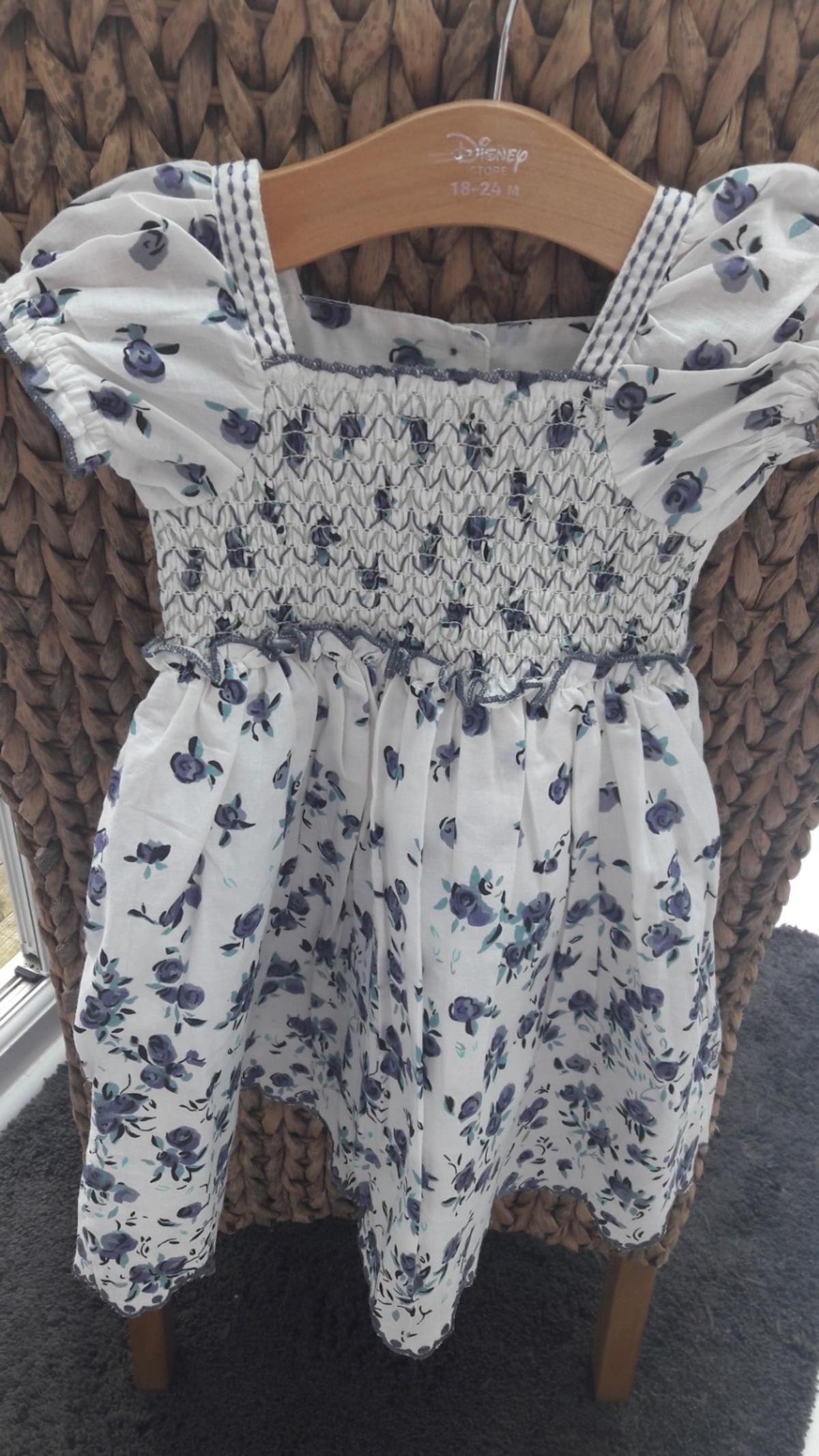 Brand new never worn Domino girls dress. Blue and white cotton smock style. Aged 2-3. Willing to accept £4 NO OFFERS PLEASE THANKS