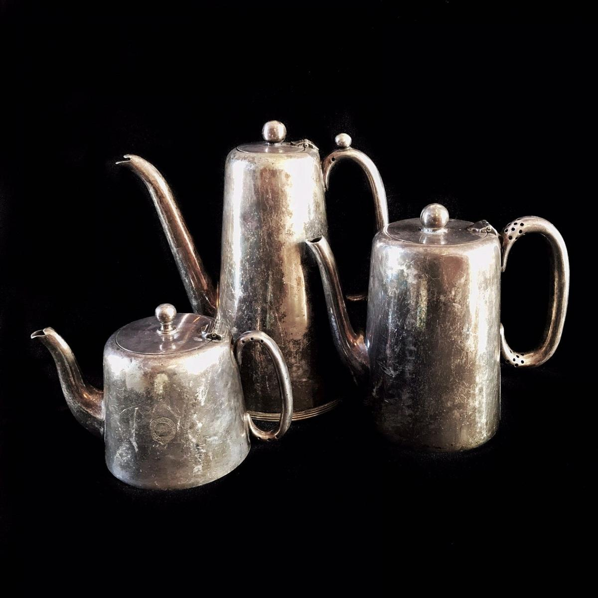 """Antique silver plated set of coffee pot, teapot, chocolate pot. Belonged to the Clarendon Royal Hotel*. The English silver plated lidded pots were used for hotel service. The decorative pieces are a great addition to antique table decor, retro shelf decor, as vintage silver vases for dry flowers composition. The patina gives antique look to the items. Hallmarks include EPNS (Electroplated). h = 10.5 cm (4 1/8"""") h = 15.5 cm (6 1/8"""") h = 21 cm (8 1/4"""") Weight: 1640 g."""