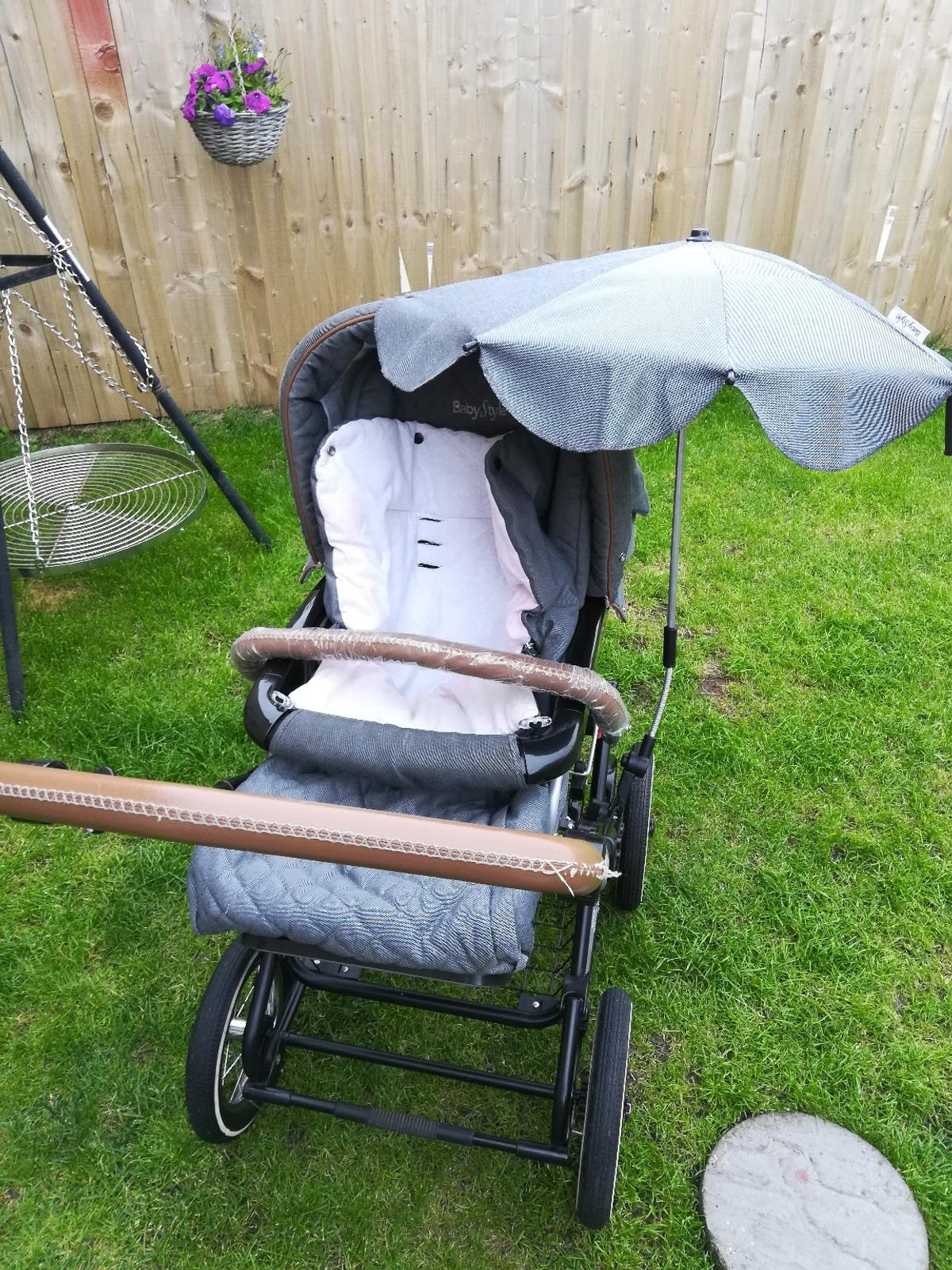 Grey and brown babystyle prestige pram. Had for nearly two years but plenty of go left in it. Comes with everything in photos and another cover for the carrycot plus one rain cover. And a new handle bar due to wear and tear on the current one. Some small marks on the chassie from getting in and out of car and another due to the umbrella. Also the foot muff is marked slightly pinky/red from my sons coat but this should come out. Great to push and goes from newborn to 3 year. open to offers
