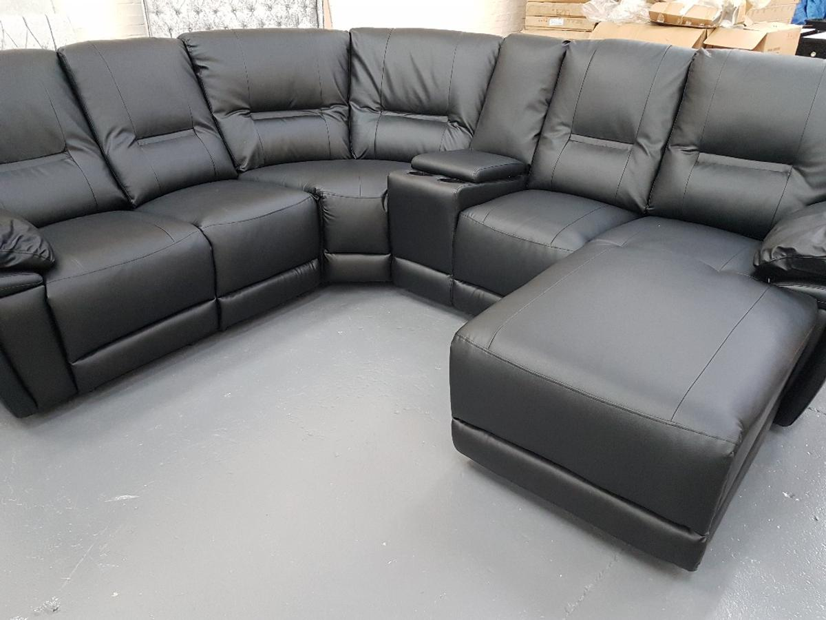 This is a large stylish black leather corner sofa with recliners and cupholders for the ultimate in comfort. New just out the wrappers!  Fast delivery available  Please msg or call/text to 07396581003