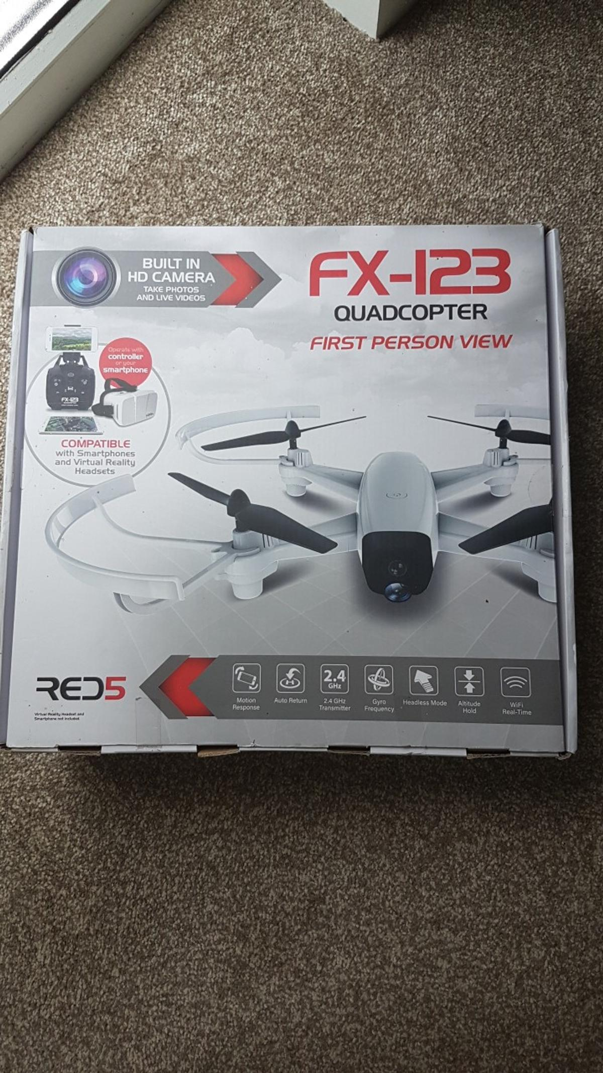 *Awesome 2.4GHz FX-123 Quadcopter in White *Adjstable HD camera *Motion response steering *Headless flying mode *Auto return home button *Three speed modes *Altitude lock *Built-in WiFi connectivity for the associated app *Connects to your smartphone (either iOS or Android) for streaming HD footage *Built in LED lights for night time flying *Measures approx. 37cm x 37cm x 7cm  rrp £95  Is in its original box Collection only