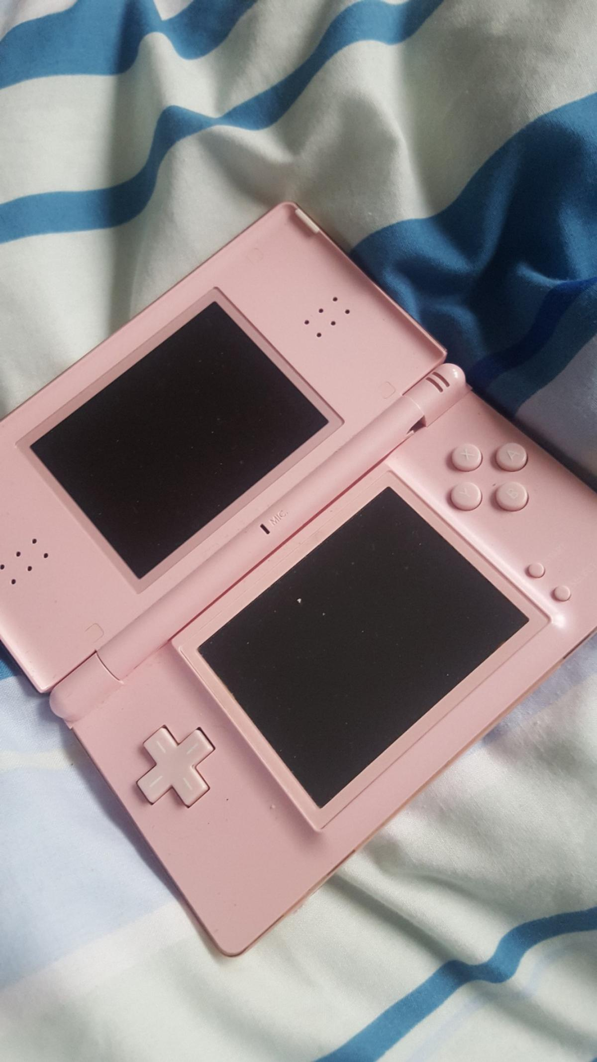 first ds with charger pink works perfectly although there is crack near hinge doesn't affect console