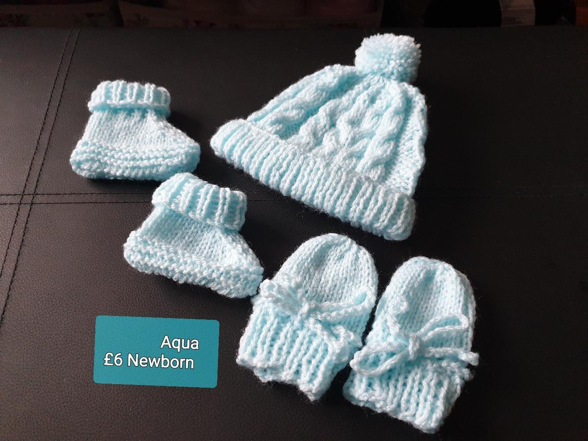 Newborn Pom Pom Hat Mittens Booties Can order colours blue,aqua,silver grey, white,pink,lilac,peach,mint lemon,deep lemon  You can Buy full Archie Set which adds the Jacket Price £10.50 Complete Set Check out in my Items FULL SET  100% ACRYLIC MACHINE WASH 40%. THIS ITEM IS HAND KNITTED BY MYSELF COMES FROM A SMOKE AND PET FREE HOME.  OPEN FOR CUSTOM BABY ORDERS MAY BE A WAITING LIST DEPENDING ON MY ÒRDERS AT THE TIME OF ORDER SO ORDER EARLY POSTAGE WILL BE £3.05