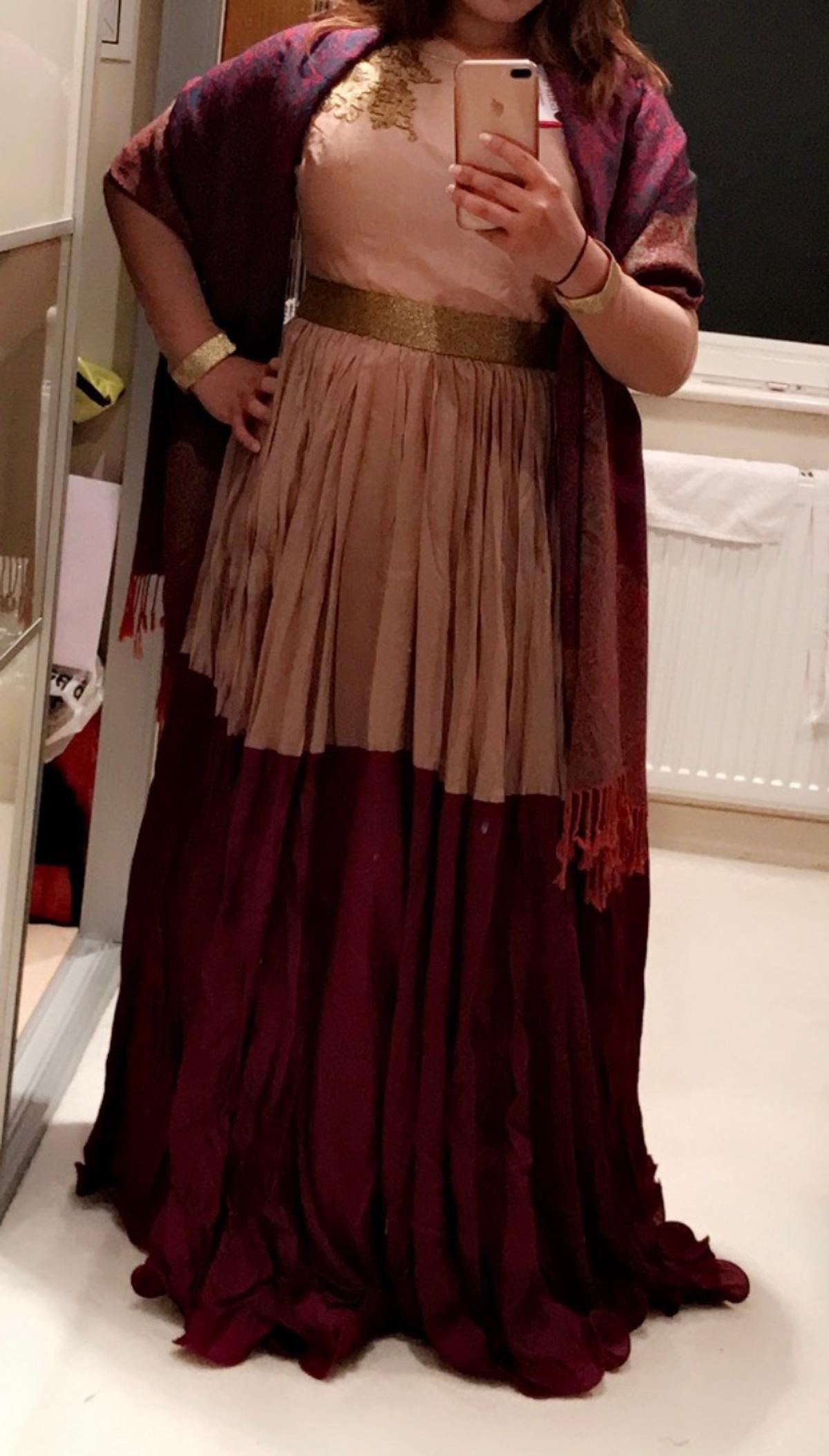 A beautiful two toned gown with a gold sequin belt at the waist (attached to the dress). Only worn twice. Size 14. £80.