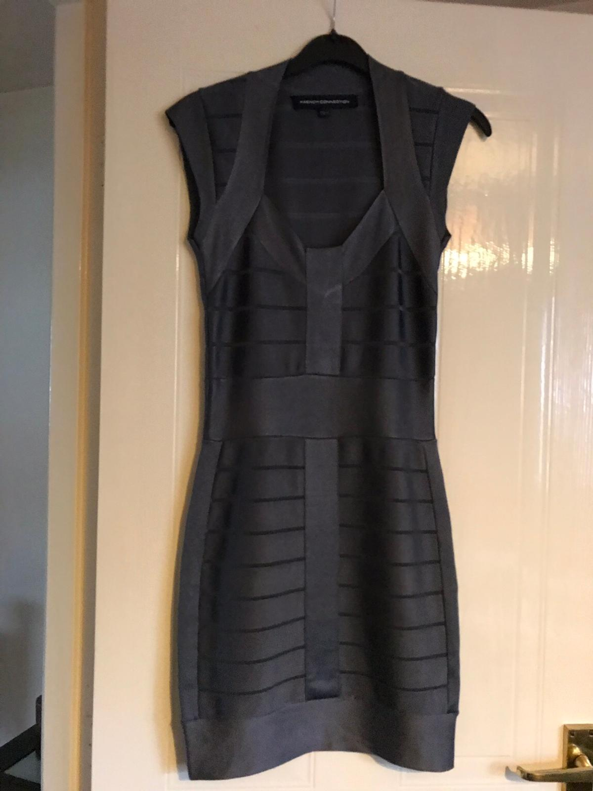 Size 8-10 hold you in material looks classy and sexy on worn twice stunning dress perfect for night out