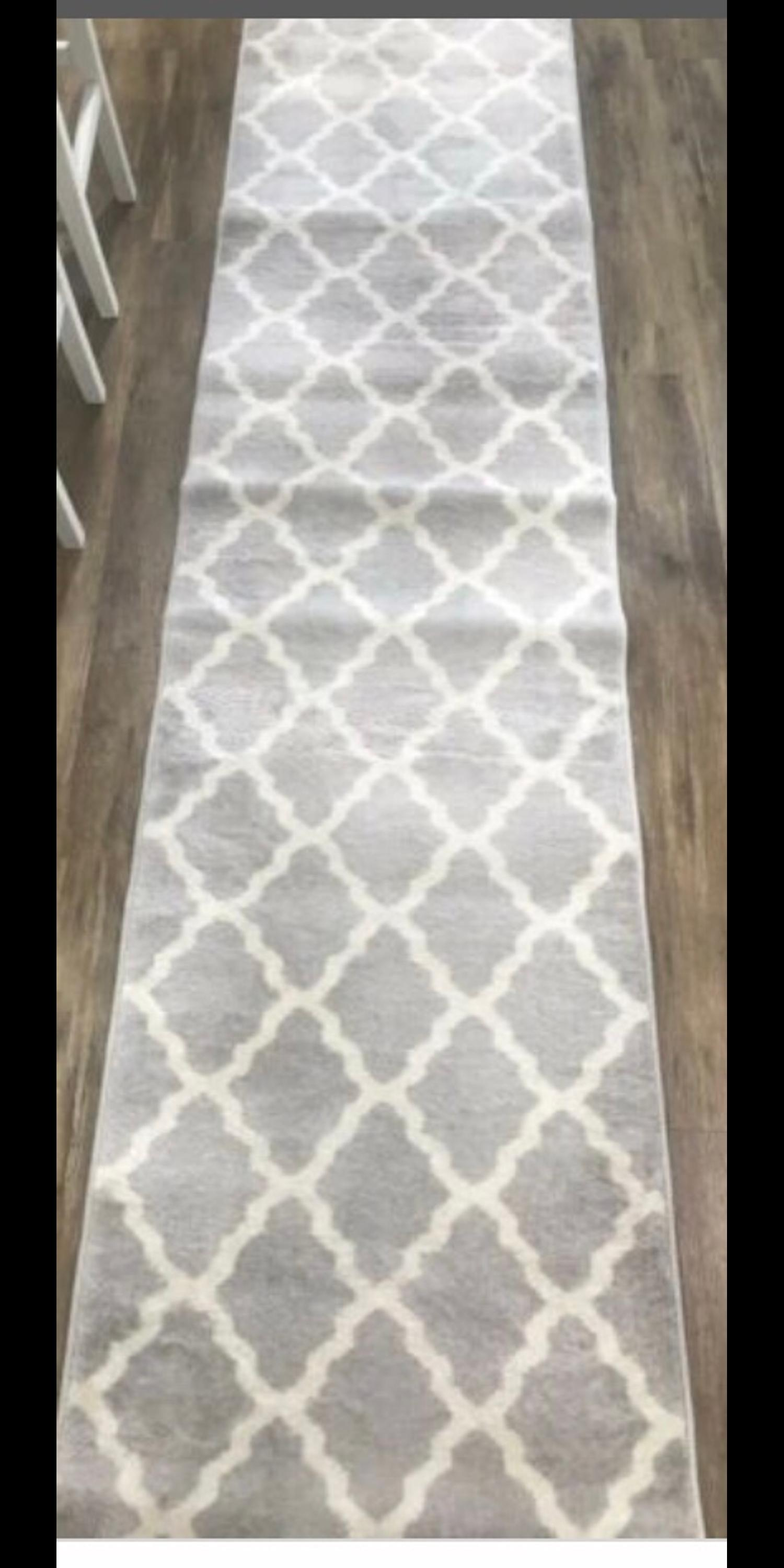 Grey and white patterned carpet runner